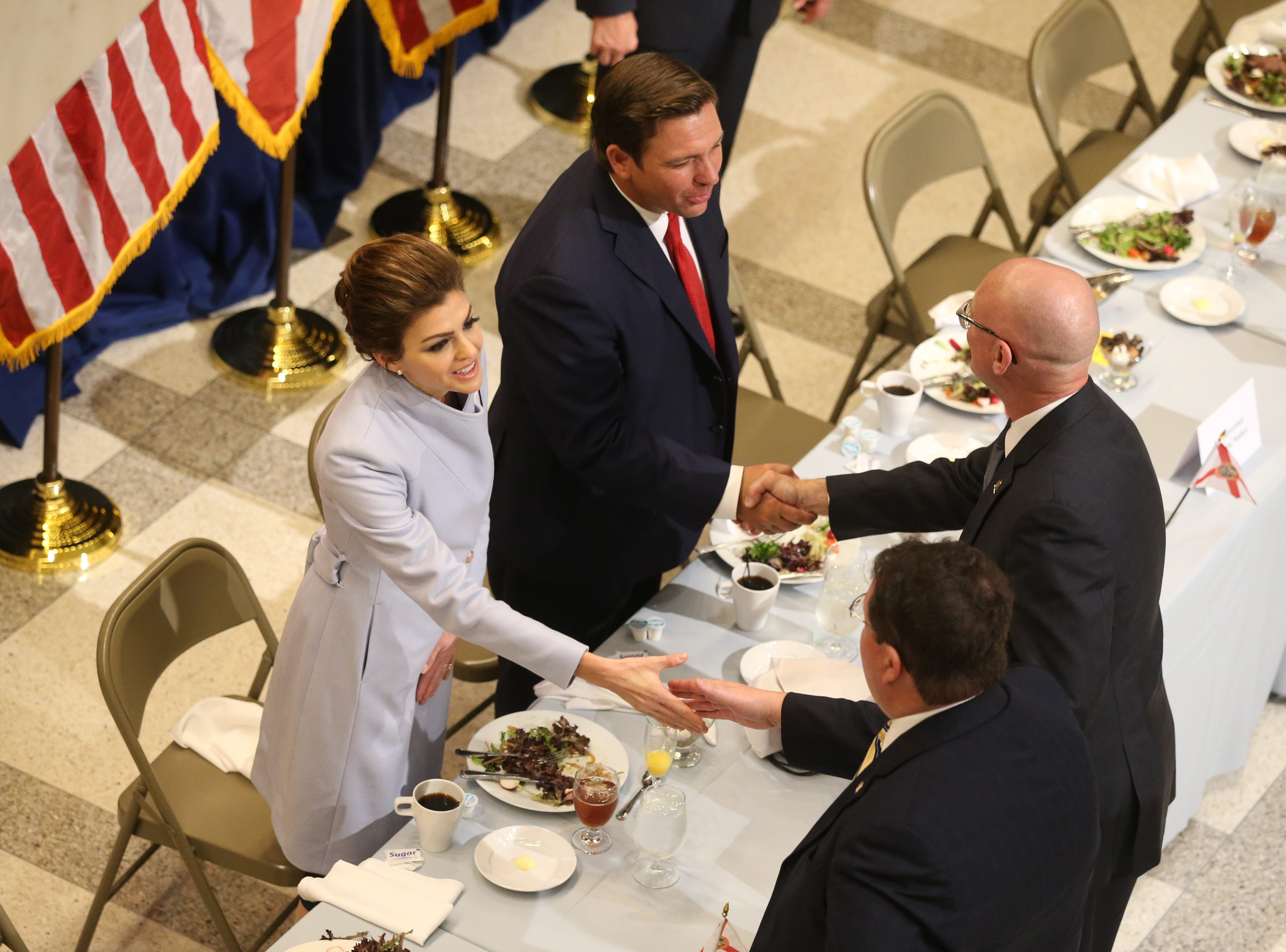 For the first time in Inaugural history, Gov. Ron DeSantis addresses FloridaÕs Legislative leaders and Cabinet officials. DeSantis discusses his plans to work with our stateÕs elected leaders to achieve a Bold Vision for a Brighter Future, Tuesday, Jan. 8, 2019. First lady Casey DeSantis, left, and husband, Gov. Ron DeSantis shake hands with guests.