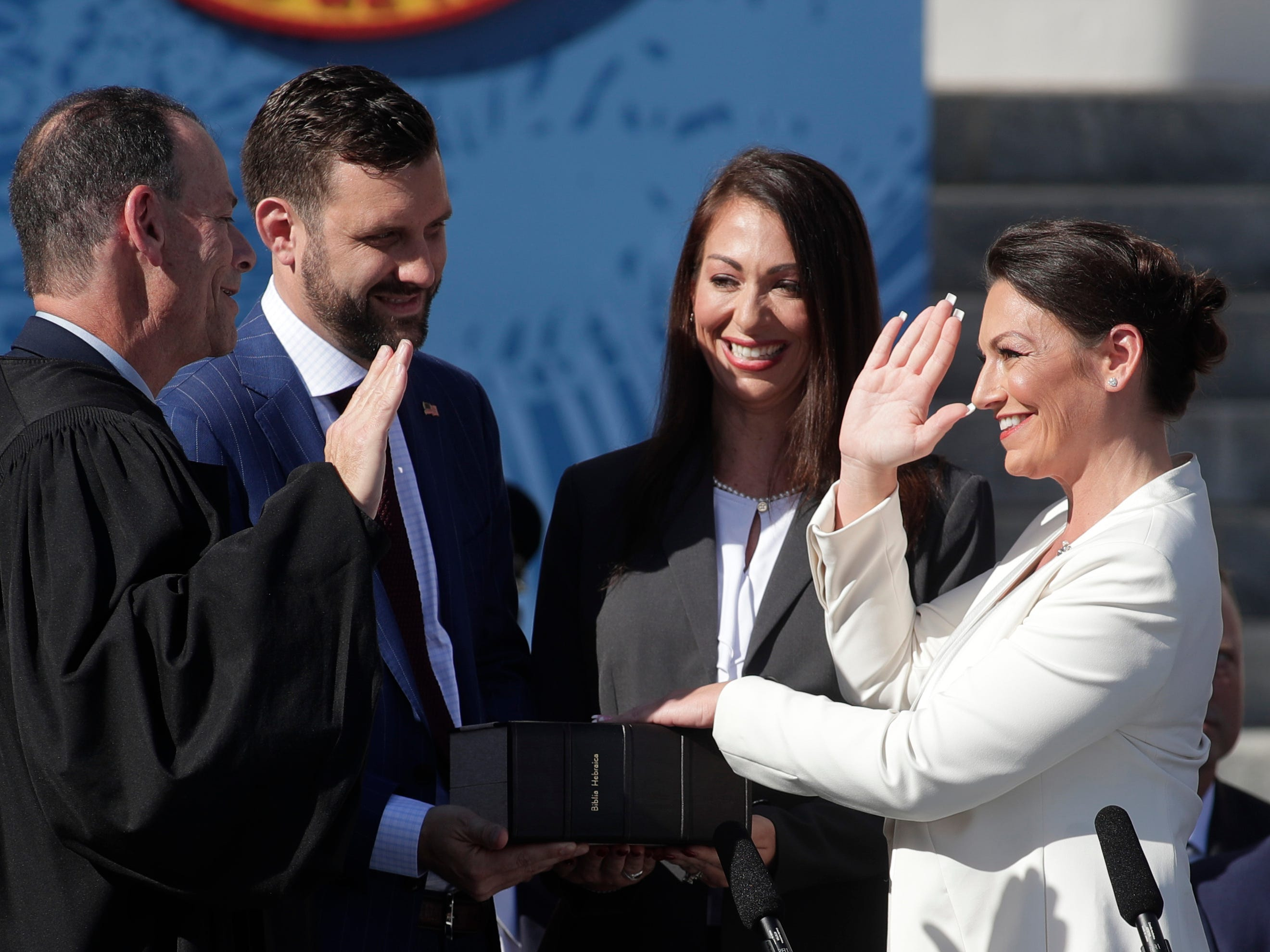 Commissioner of Agriculture and Consumer Services Nikki Fried is sworn in by Judge Kevin Emas with her partner, Jake Bergmann, and sister Jenni Shaffren during the 2019 inauguration ceremony on the steps of the Historic Capitol Building in Tallahassee on Tuesday, Jan. 8, 2019.