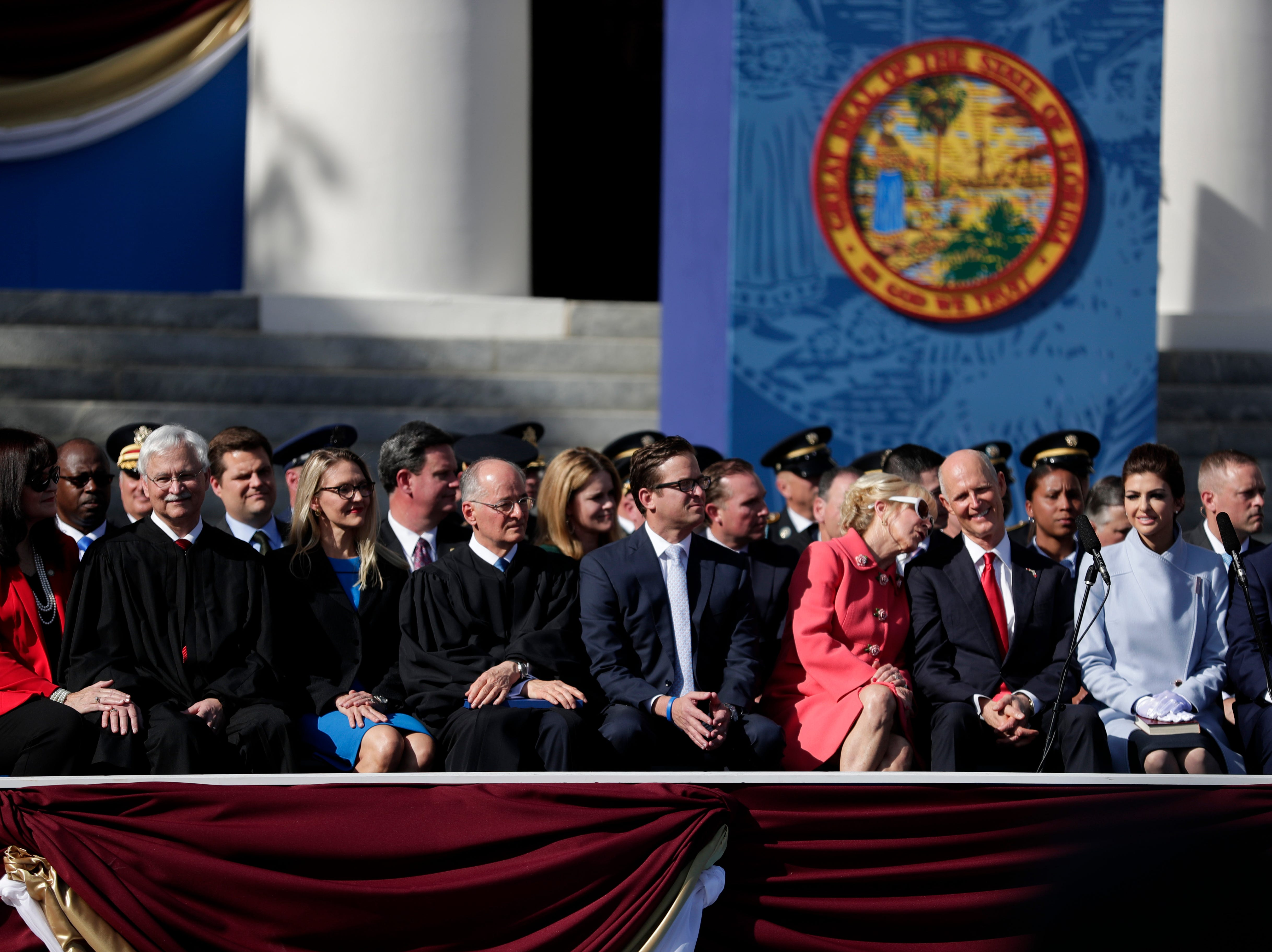 Former first lady Ann Scott and former governor Rick Scott share thoughts during the 2019 inauguration ceremony on the steps of the Historic Capitol Building in Tallahassee Tuesday, Jan. 8, 2019.