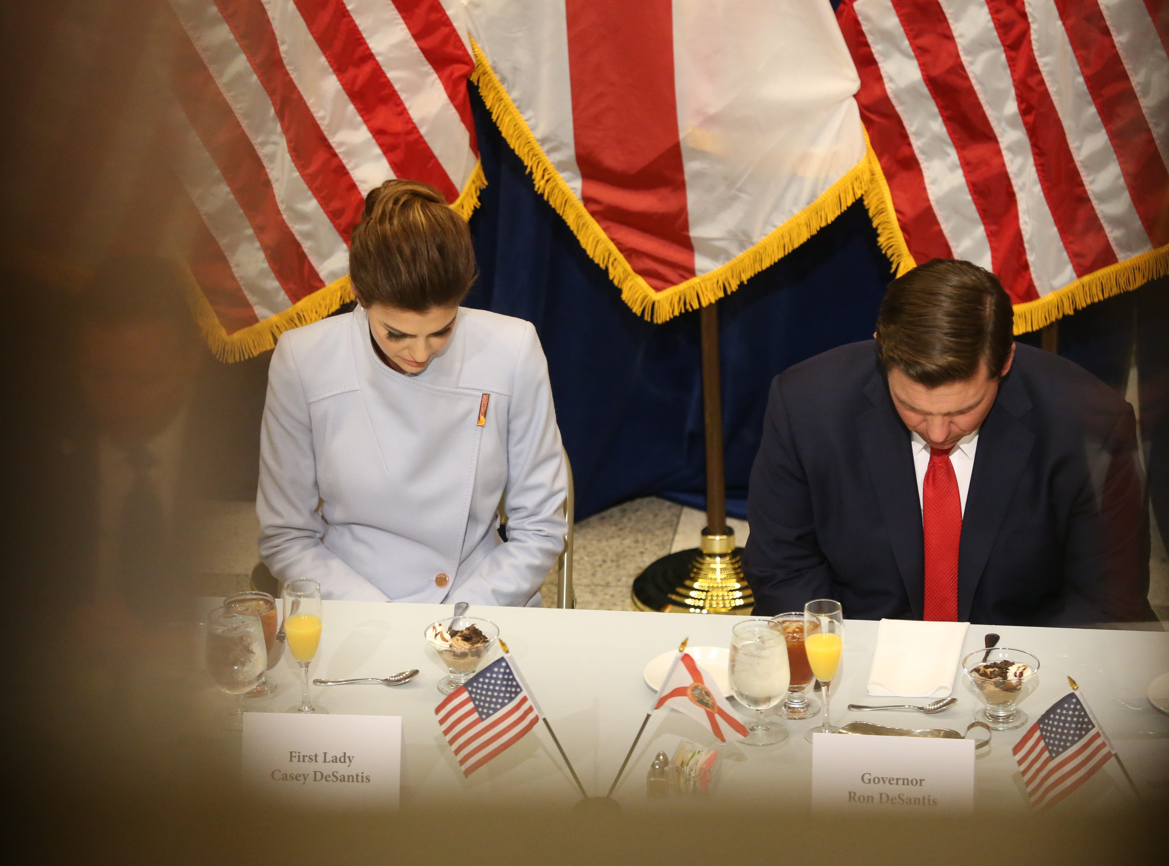 For the first time in Inaugural history, Gov. Ron DeSantis addresses FloridaÕs Legislative leaders and Cabinet officials. DeSantis discusses his plans to work with our stateÕs elected leaders to achieve a Bold Vision for a Brighter Future, Tuesday, Jan. 8, 2019. First lady Casey DeSantis and her husband, Gov. Ron DeSantis bow their head in prayer before the luncheon.