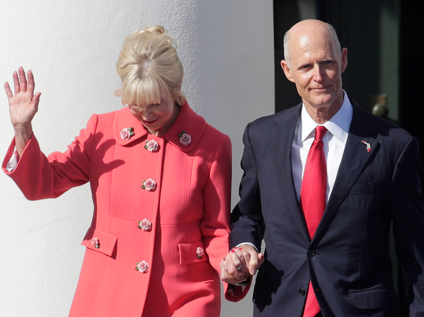 Former Governor Rick Scott and his wife Ann Scott take their seats during the 2019 inauguration ceremony on the steps of the Historic Capitol Building in Tallahassee Tuesday, Jan. 8, 2019.