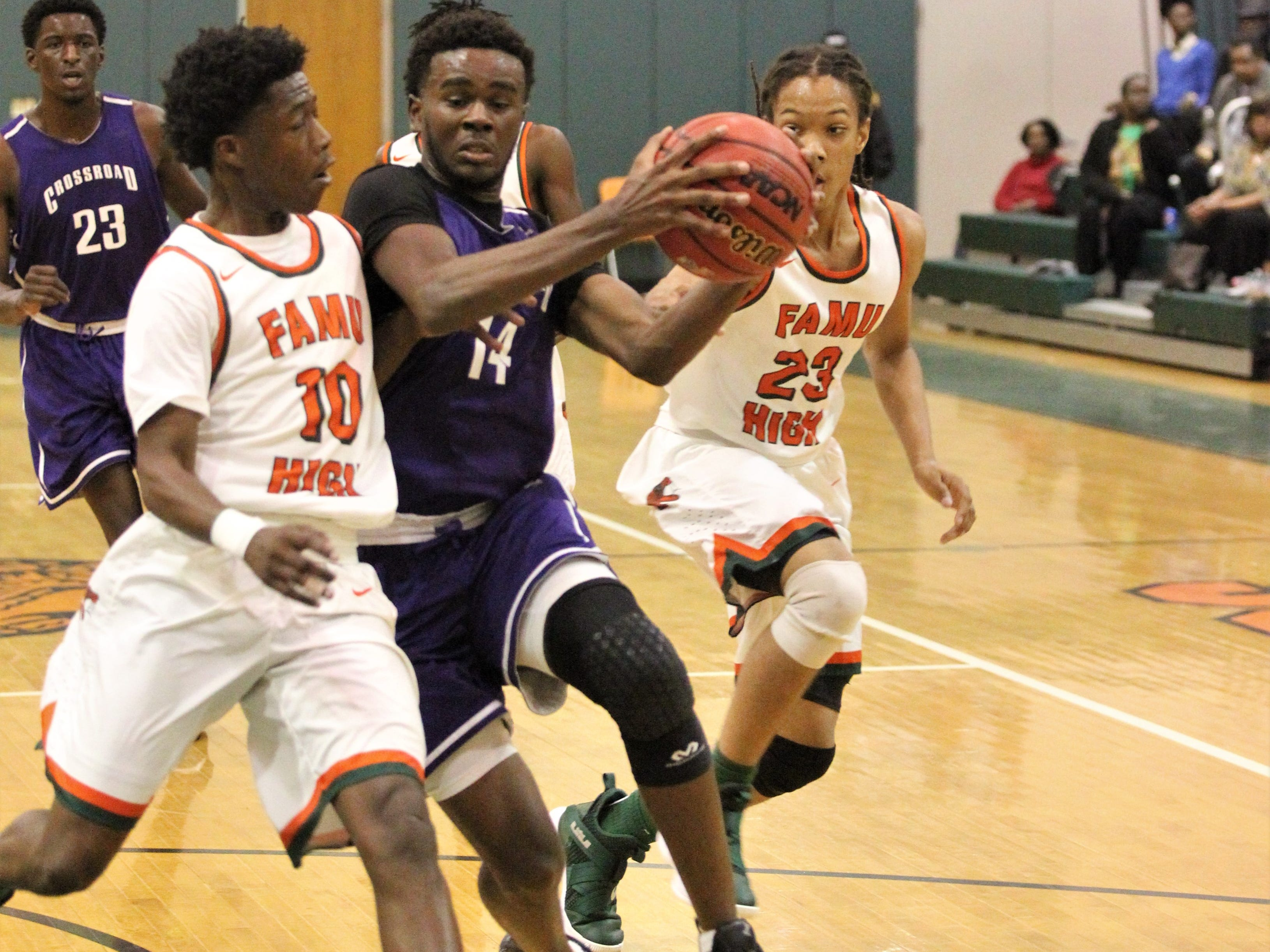 Jalan Black drives to the basket as Crossroad Academy's boys basketball team plays at FAMU DRS on Jan. 7, 2019.