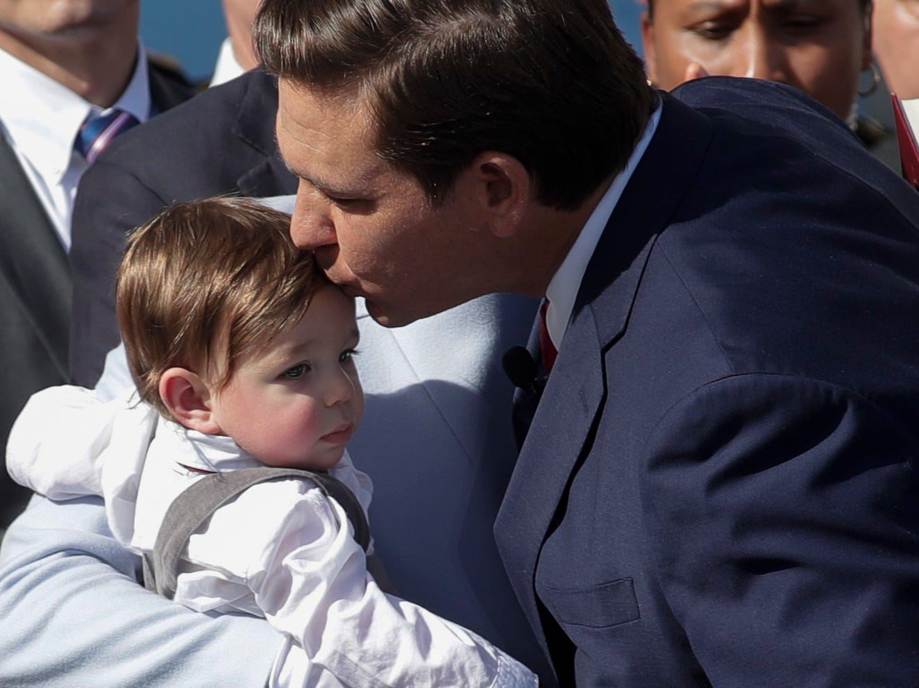 Gov. Ron DeSantis kisses his son Mason on the forehead after taking the oath of office during the 2019 inauguration ceremony on the steps of the Historic Capitol Building in Tallahassee Tuesday, Jan. 8, 2019.