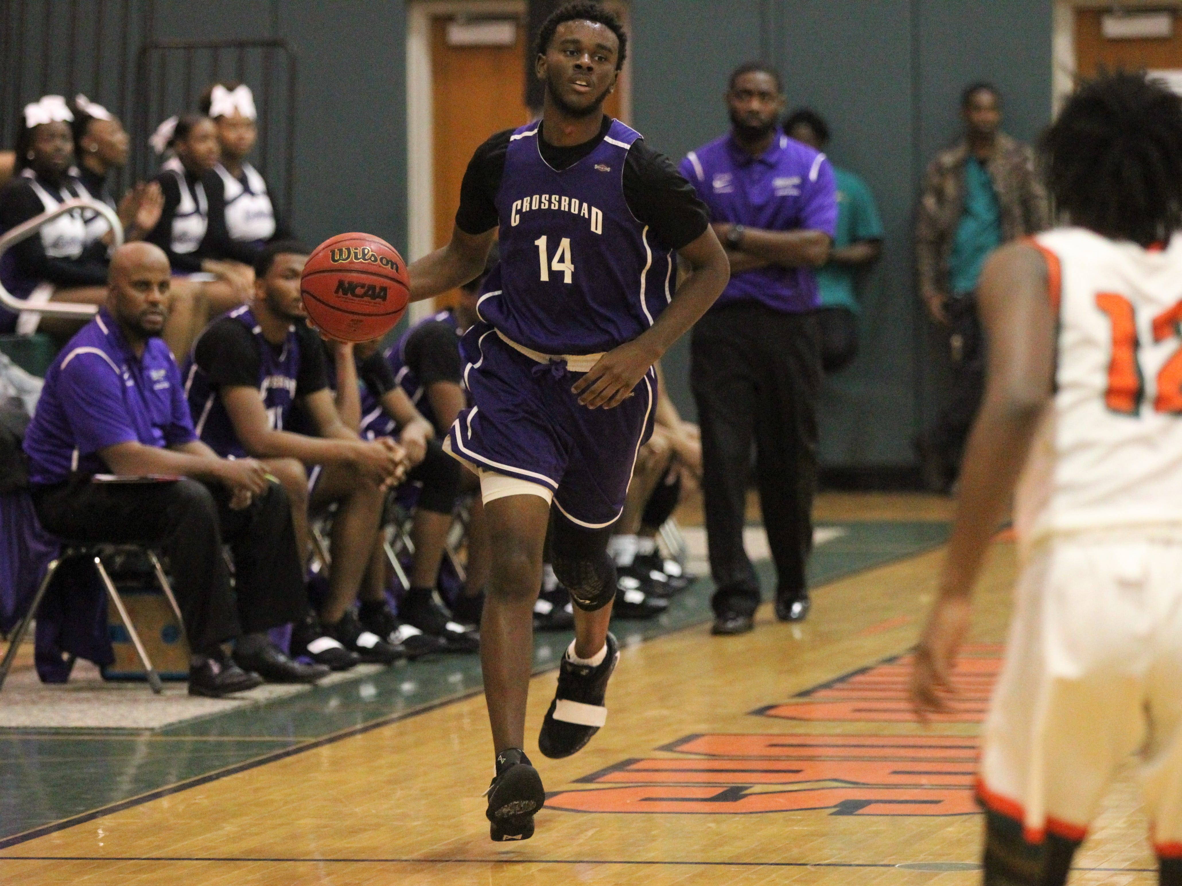 Jalan Black brings the ball up the court as Crossroad Academy's boys basketball team plays at FAMU DRS on Jan. 7, 2019.