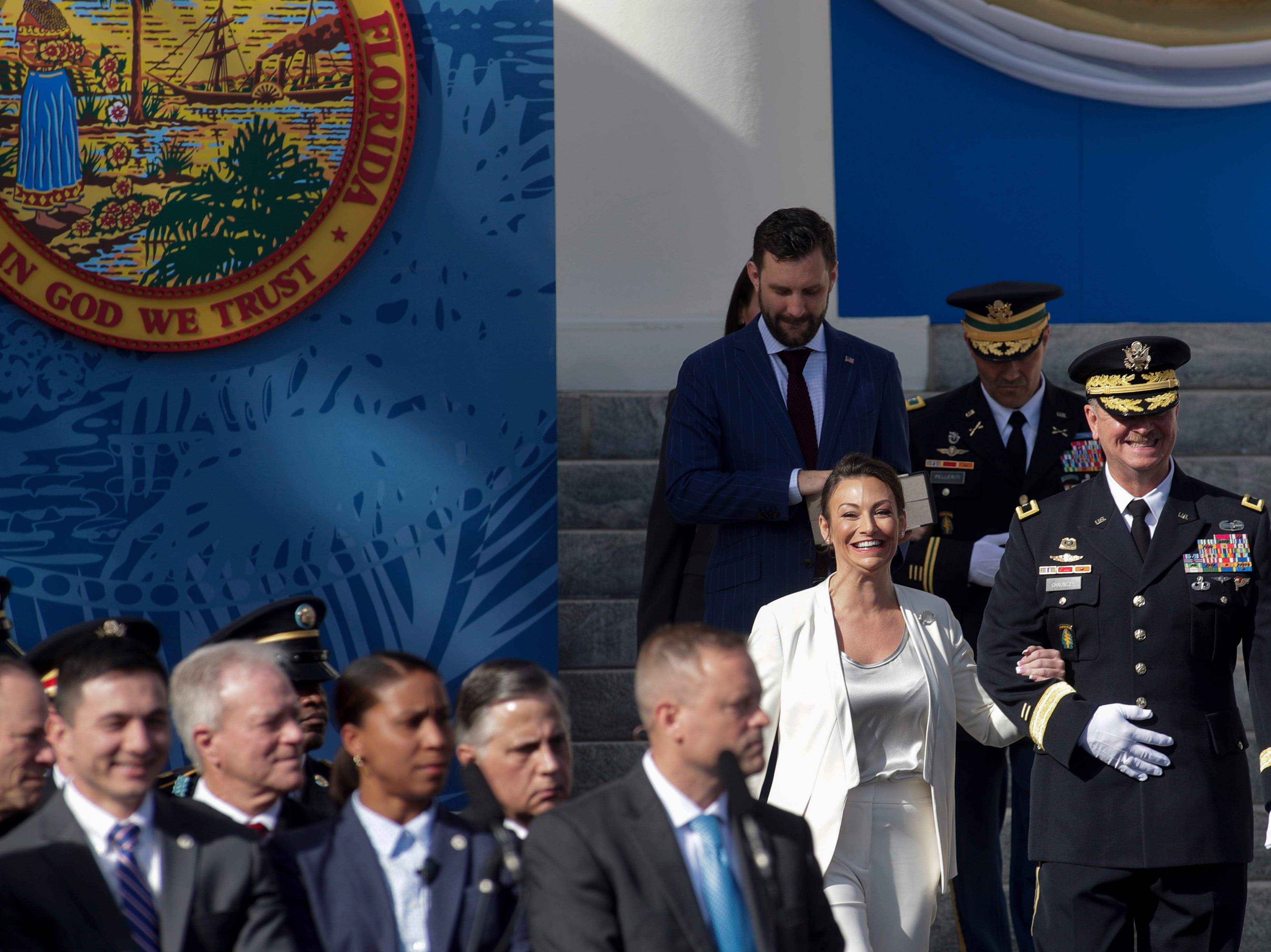 Commissioner of Agriculture and Consumer Services Nikki Fried is escorted to her seat during the 2019 inauguration ceremony on the steps of the Historic Capitol Building in Tallahassee Tuesday, Jan. 8, 2019.