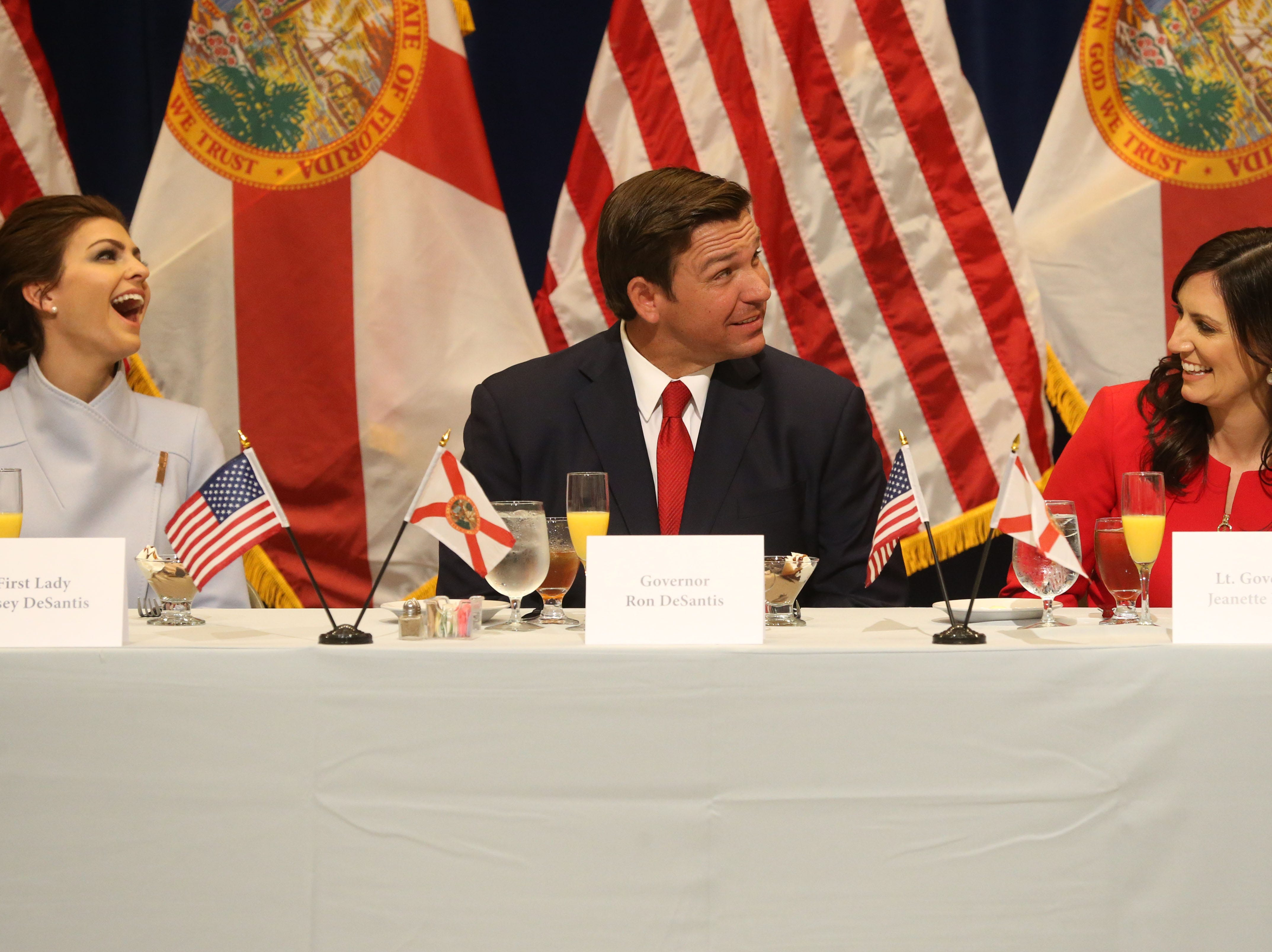 For the first time in Inaugural history, Gov. Ron DeSantis addresses FloridaÕs Legislative leaders and Cabinet officials. DeSantis discusses his plans to work with our stateÕs elected leaders to achieve a Bold Vision for a Brighter Future, Tuesday, Jan. 8, 2019. First lady Casey DeSantis, left, Gov. Ron DeSantis, and Lt. Gov. Jeanette Nunez burst out in laughter during a toast given by Senate President Bill Galvano.