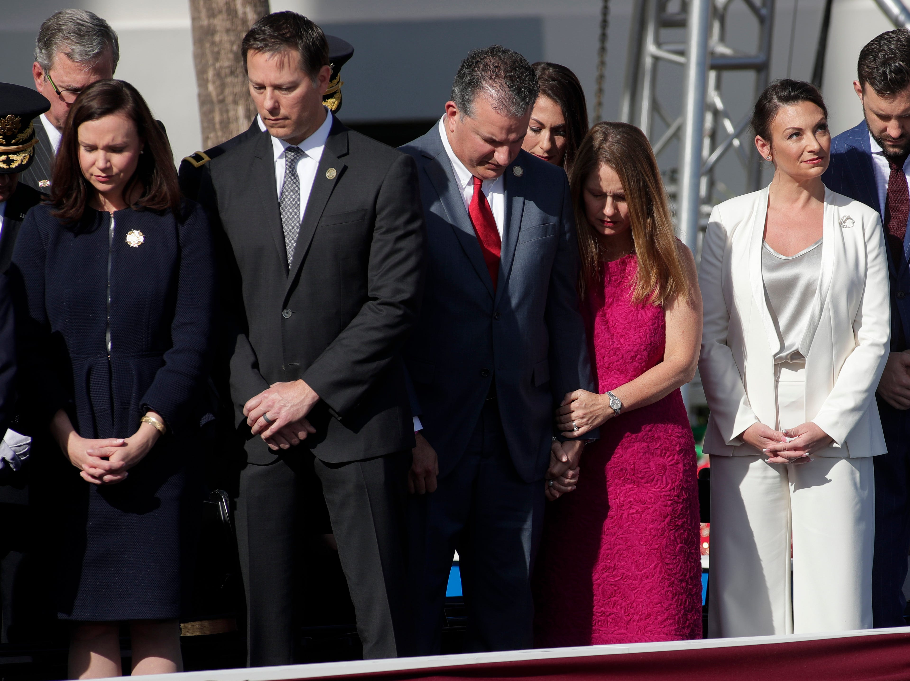 Commissioner of Agriculture and Consumer Services Nikki Fried looks to the sky during an invocation by Rev. Gary Johnson during the 2019 inauguration ceremony on the steps of the Historic Capitol Building in Tallahassee Tuesday, Jan. 8, 2019.