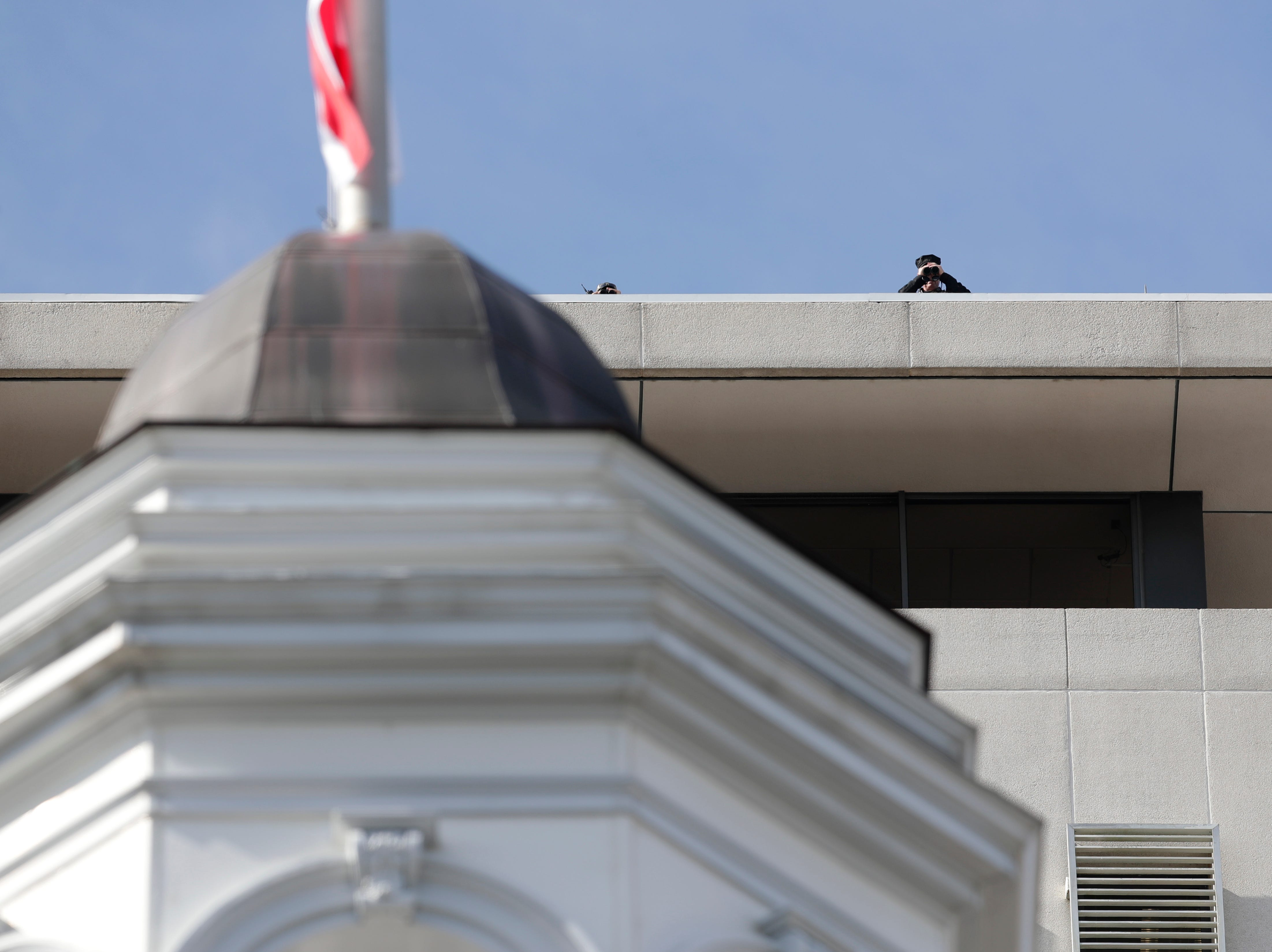 Law enforcement officers stake out from the top of the Capitol during the 2019 inauguration ceremony on the steps of the Historic Capitol Building in Tallahassee Tuesday, Jan. 8, 2019.
