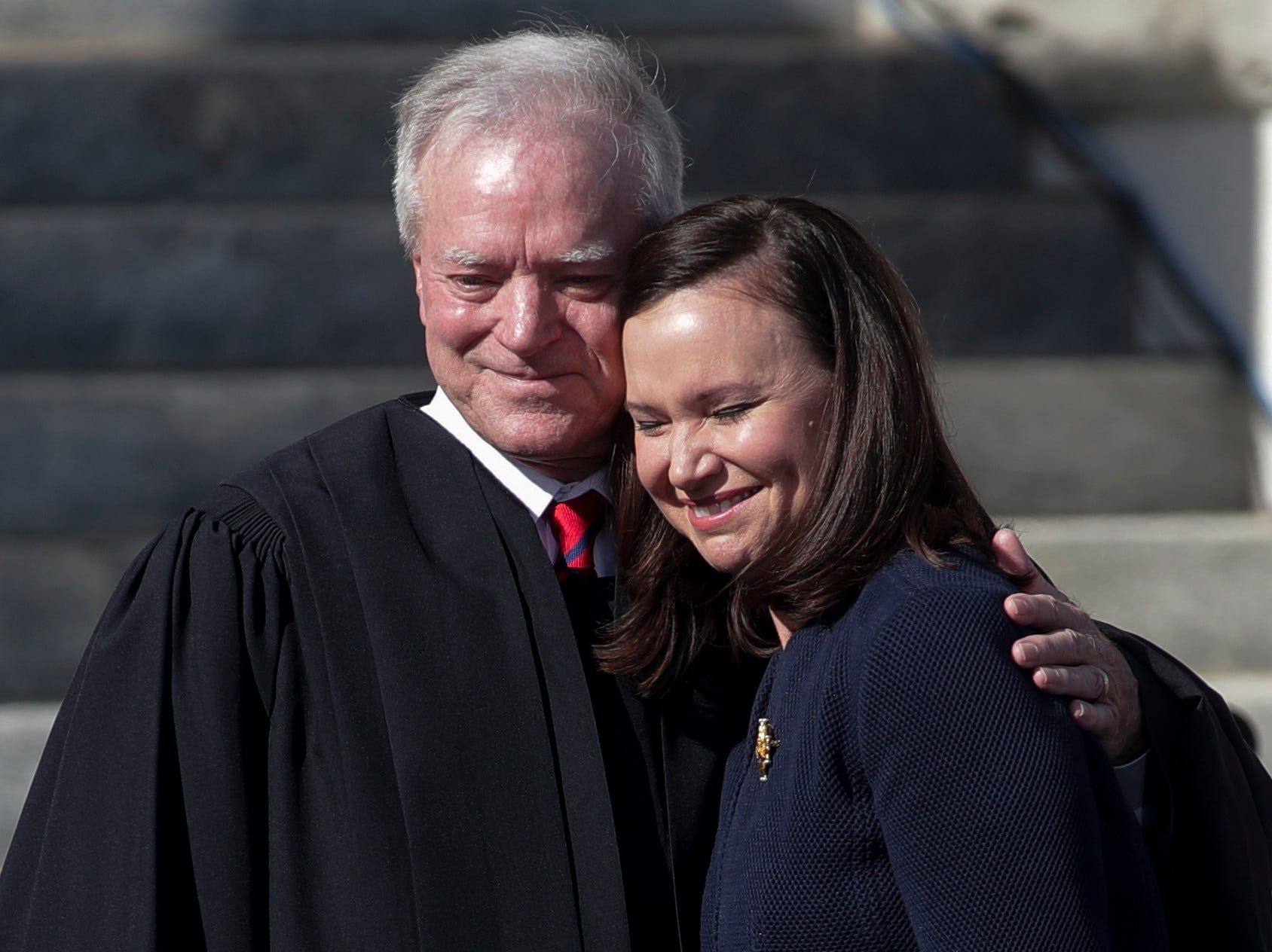 Attorney General Ashley Moody hugs her father Judge James S. Moody before he administers the oath of office to her during the 2019 inauguration ceremony on the steps of the Historic Capitol Building in Tallahassee Tuesday, Jan. 8, 2019.
