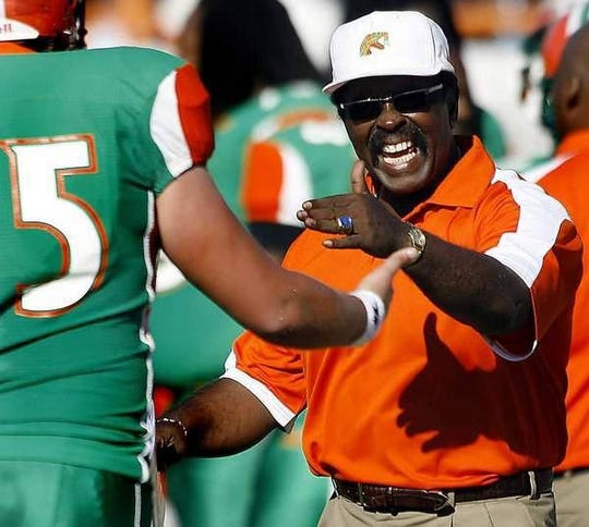 Joe Taylor gives instructions to a player at FAMU. The former head coach will be immortalized in the College Football Hall of Fame.