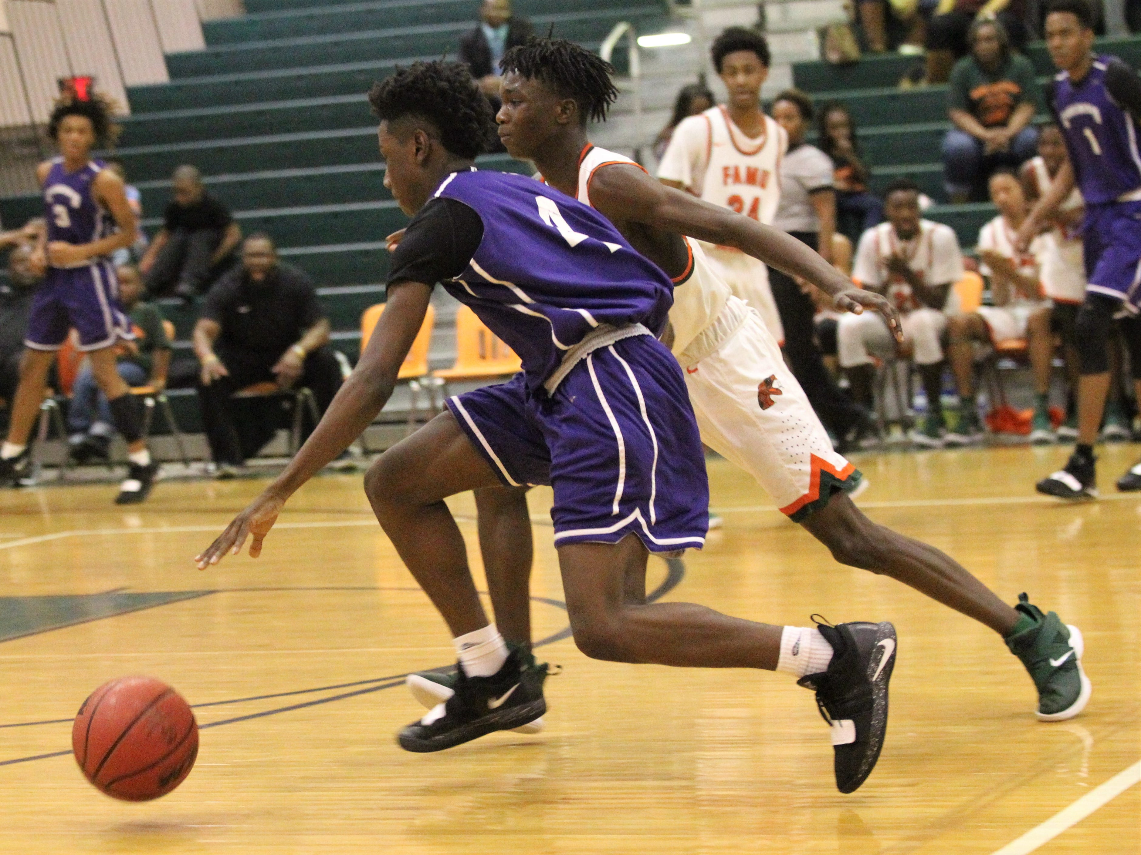 Deonta Jones brings the ball up the court as Crossroad Academy's boys basketball team plays at FAMU DRS on Jan. 7, 2019.
