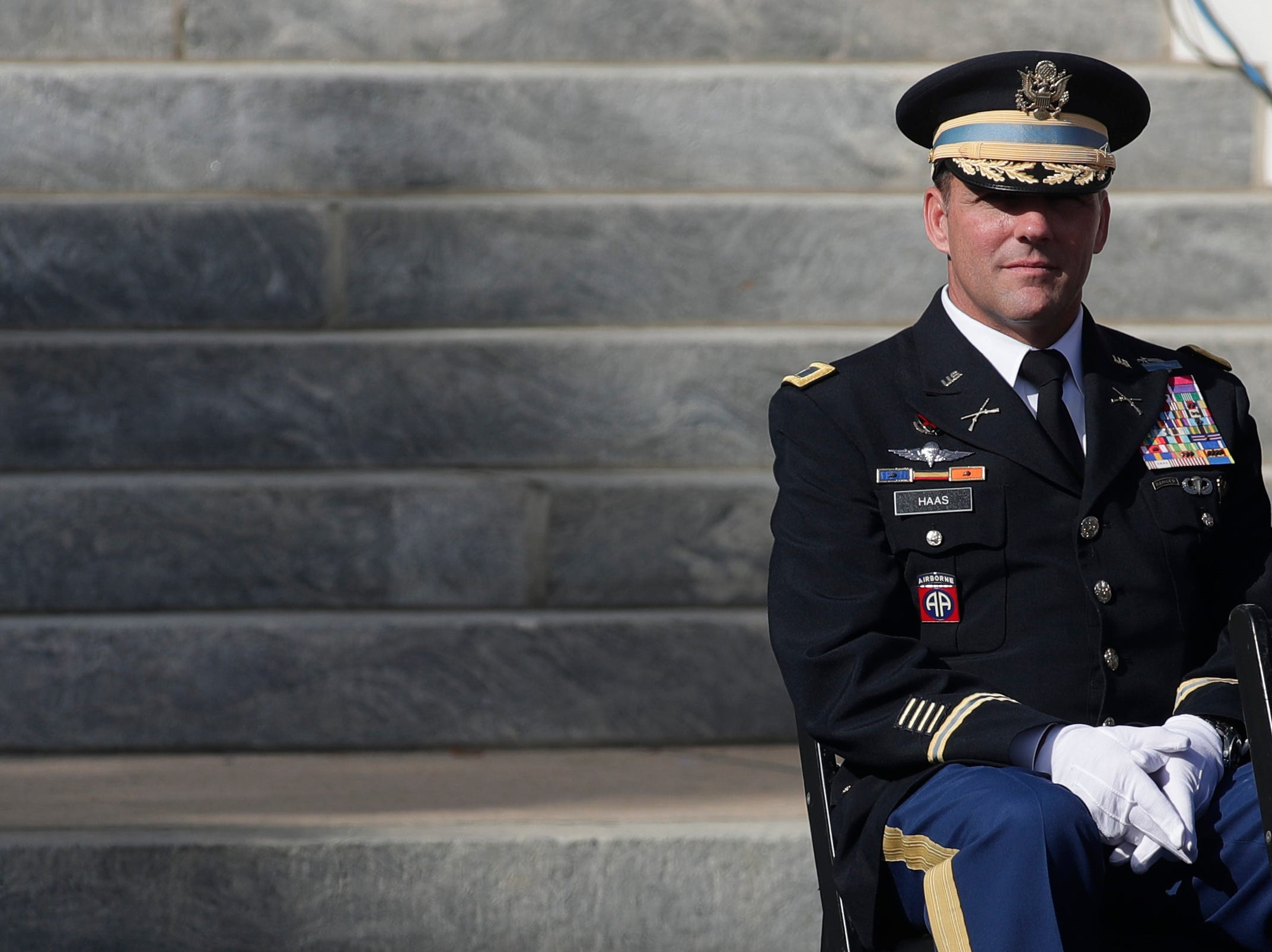 A member of the military sits on stage during the 2019 inauguration ceremony on the steps of the Historic Capitol Building in Tallahassee Tuesday, Jan. 8, 2019.