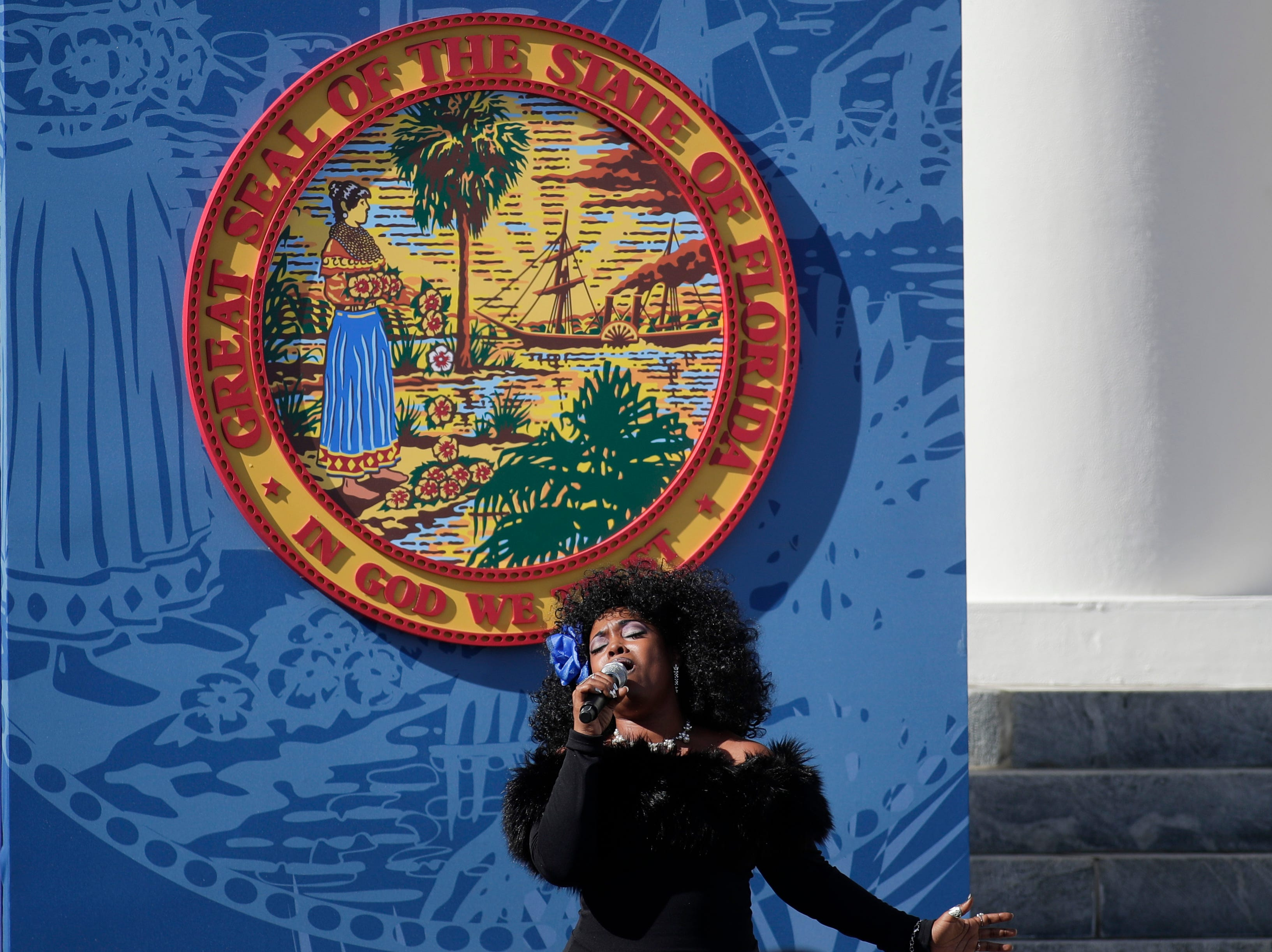 """Mama Blue sings """"God Bless America"""" during the 2019 inauguration ceremony on the steps of the Historic Capitol Building in Tallahassee Tuesday, Jan. 8, 2019."""