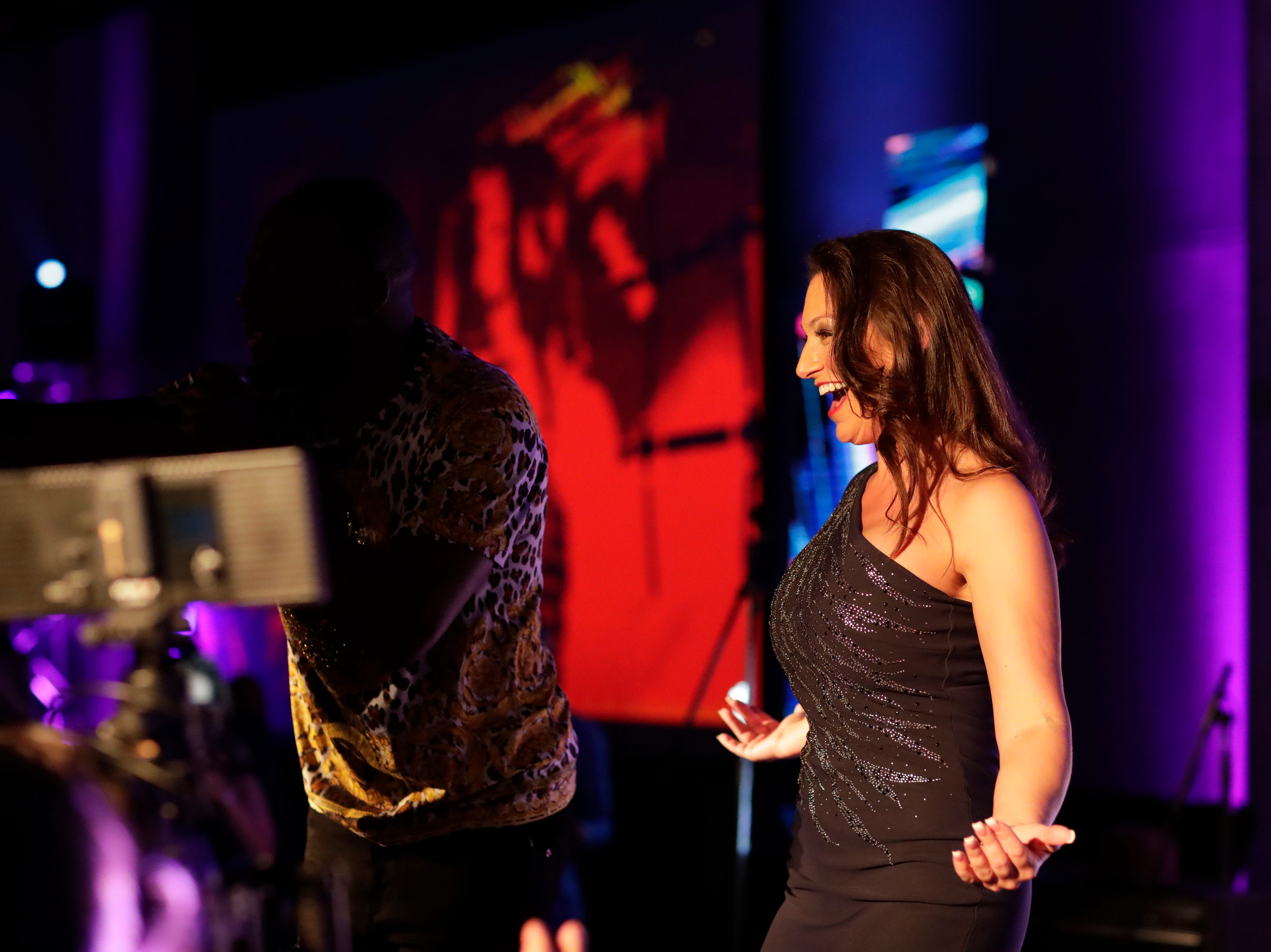 """Commissioner of Agriculture and Consumer Services Nikki Fried dances with guests on stage as Wyclef Jean performs during the """"Growing a Stronger Florida"""" Inaugural Celebration honoring Fried in the University Center Club at Florida State University Monday, Jan. 7, 2019."""