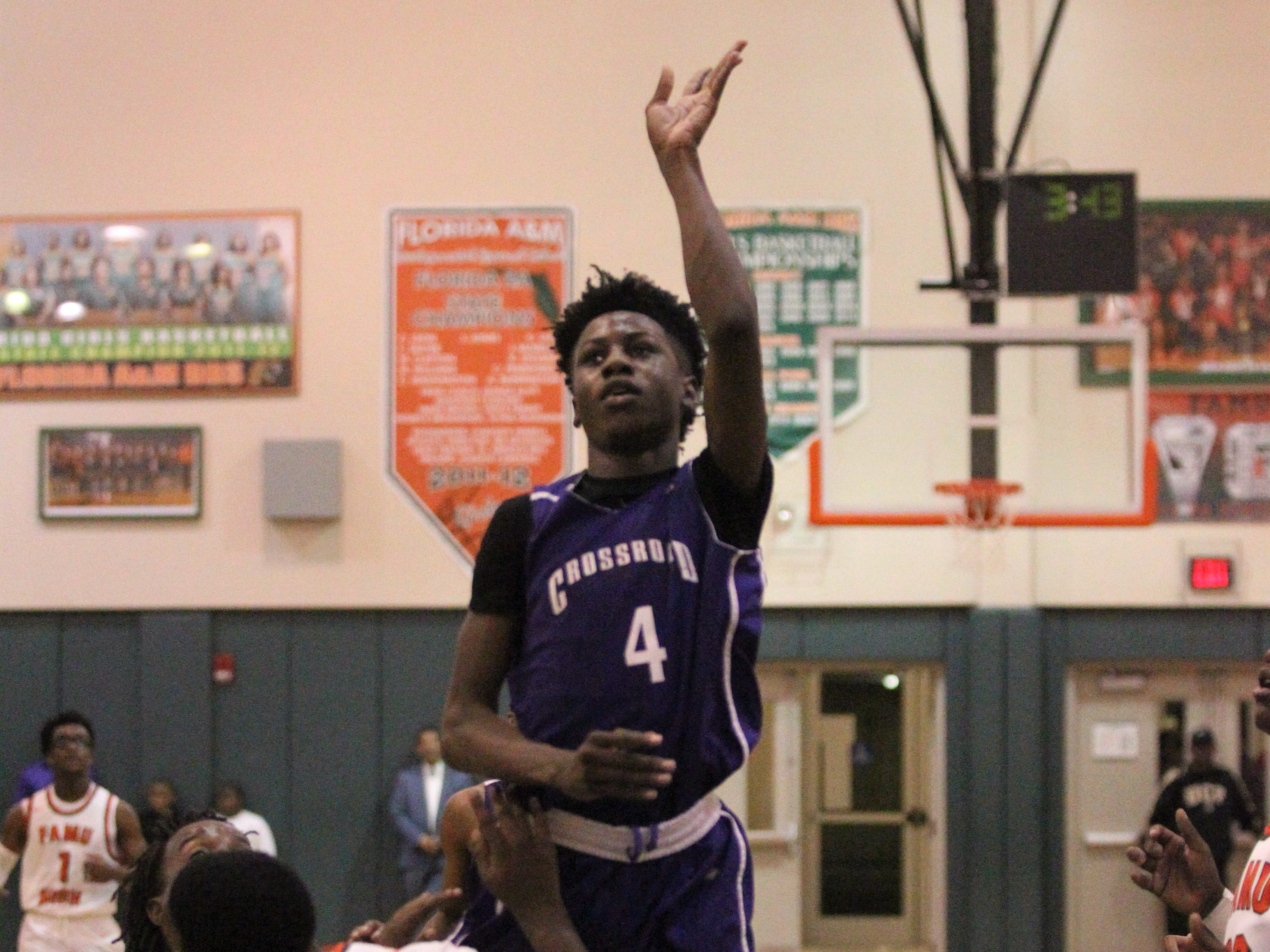 Deonta Jones goes for a runner but is calling for a foul as Crossroad Academy's boys basketball team plays at FAMU DRS on Jan. 7, 2019.