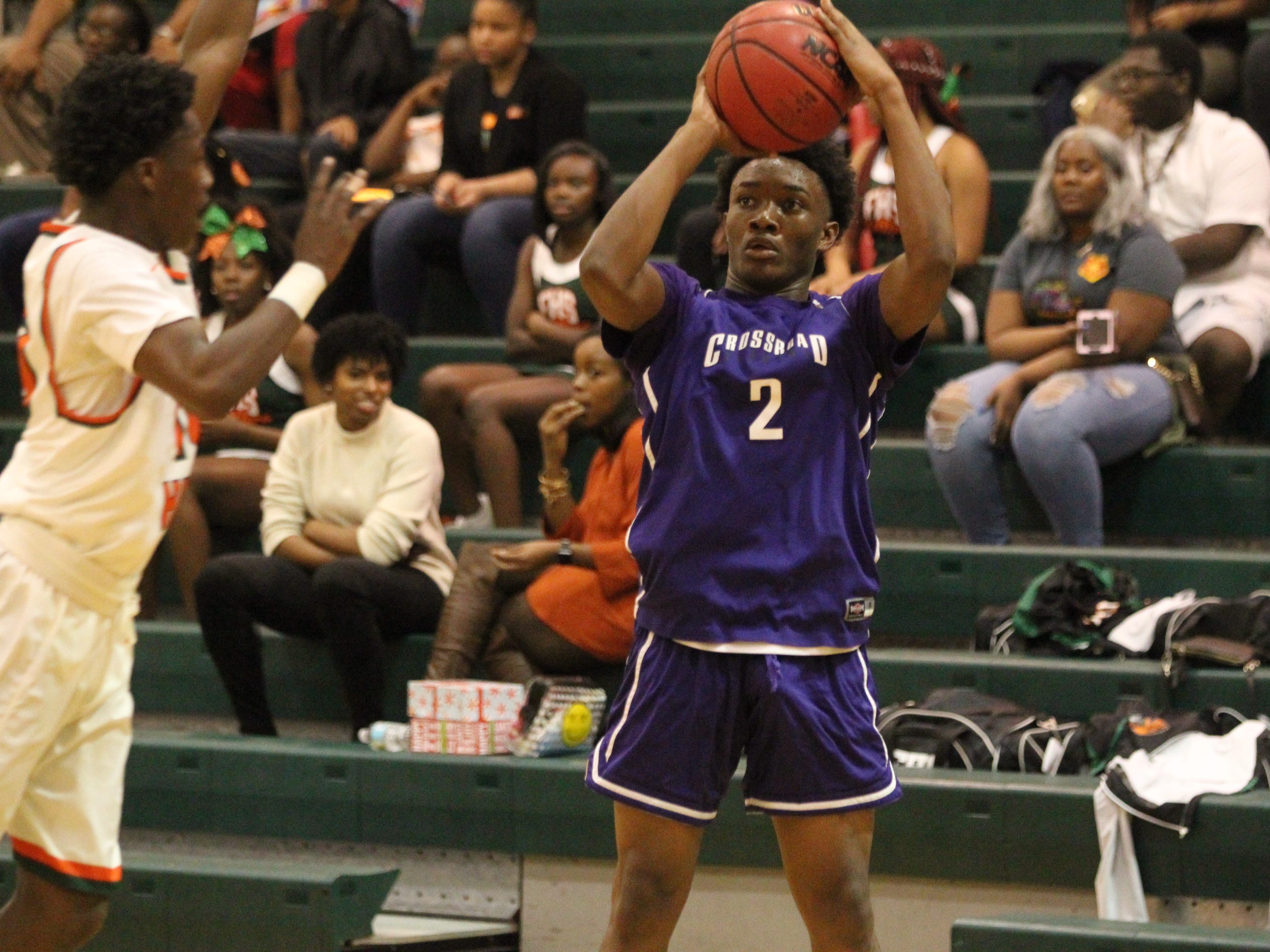 Jeremiah Outley shoots a 3-pointer as Crossroad Academy's boys basketball team plays at FAMU DRS on Jan. 7, 2019.
