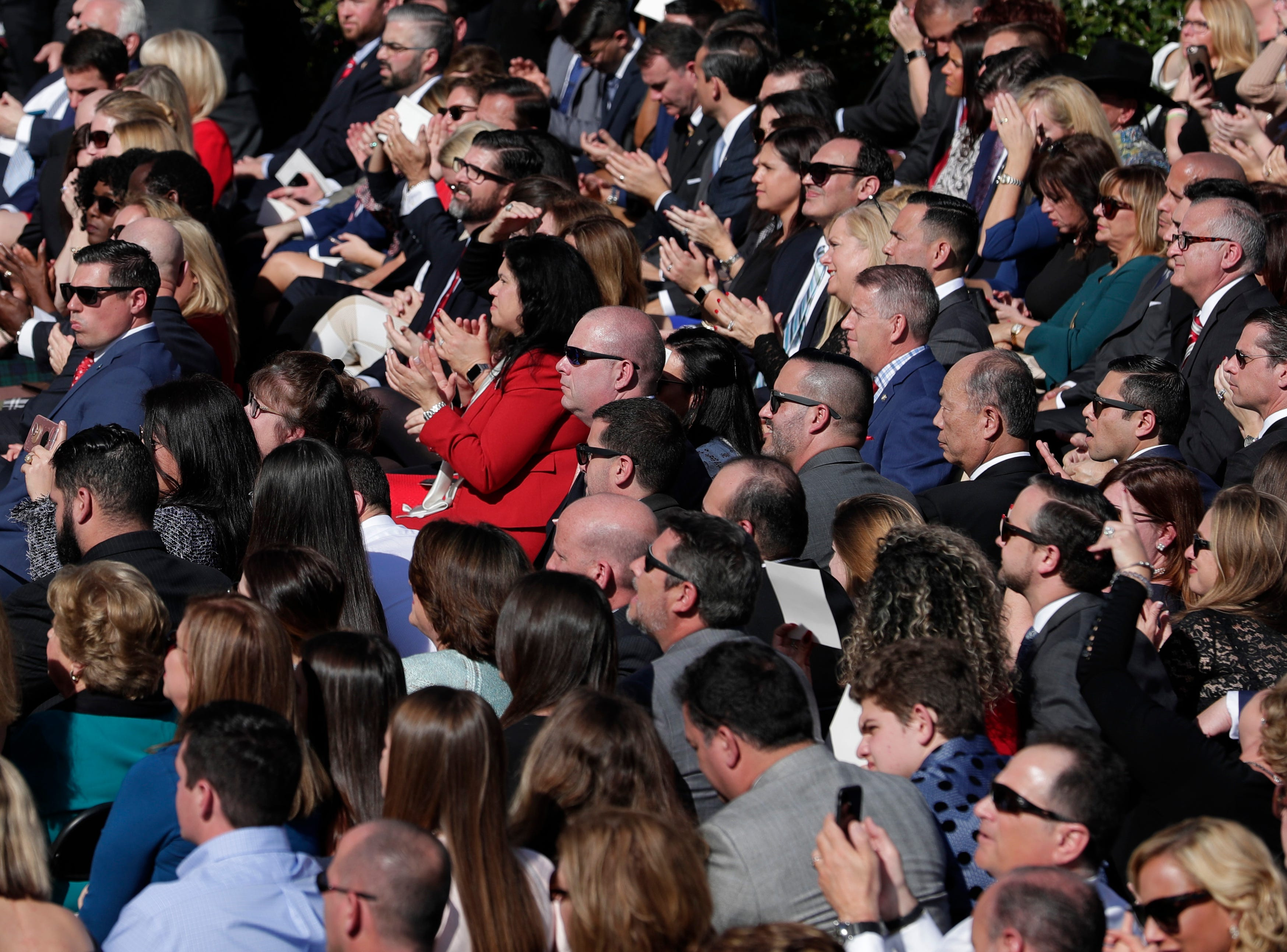 The crowd claps as dignitaries are introduced during the 2019 inauguration ceremony on the steps of the Historic Capitol Building in Tallahassee Tuesday, Jan. 8, 2019.