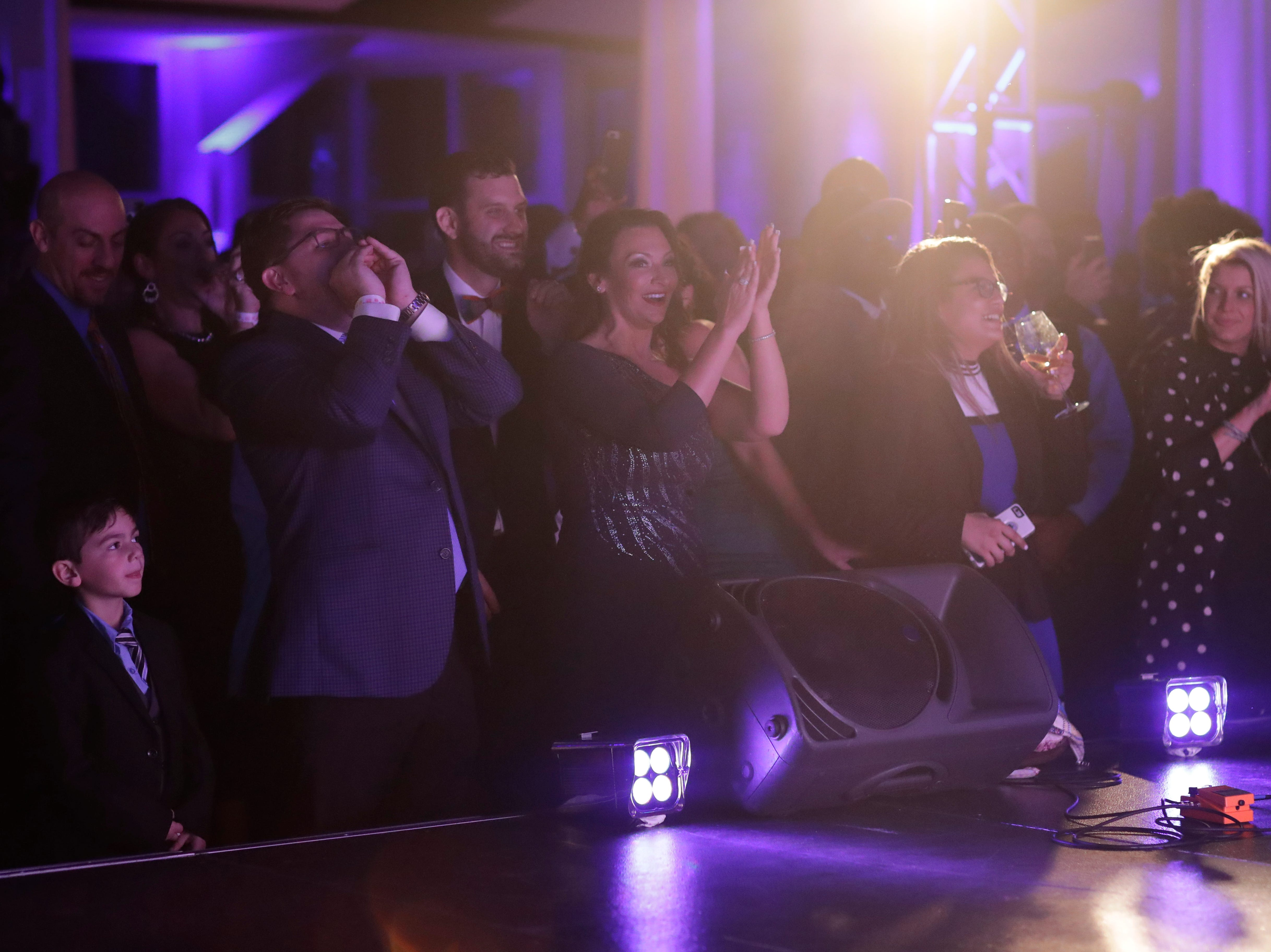 """Commissioner of Agriculture and Consumer Services Nikki Fried dances as Wyclef Jean performs during the """"Growing a Stronger Florida"""" Inaugural Celebration honoring Fried in the University Center Club at Florida State University Monday, Jan. 7, 2019."""