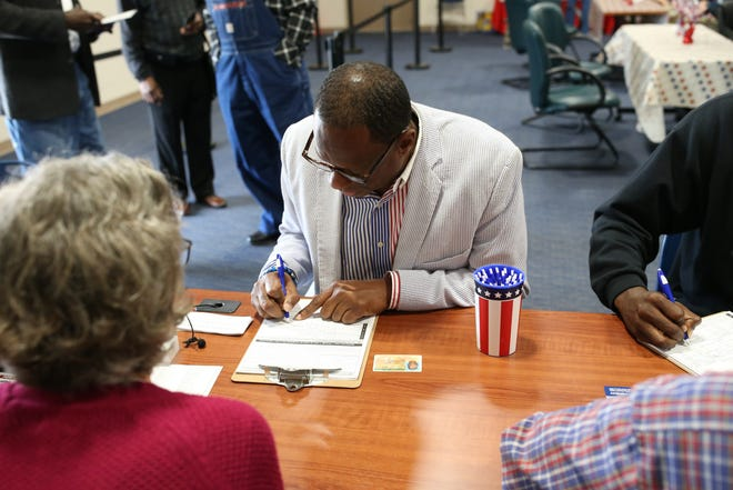Gregory James fills out paperwork to register to vote at the Supervisor of Elections office in Tallahassee on Jan. 8, 2019, the day Amendment 4 takes effect. The amendment restores the right to vote for felons not convicted on sex offenses or murder.