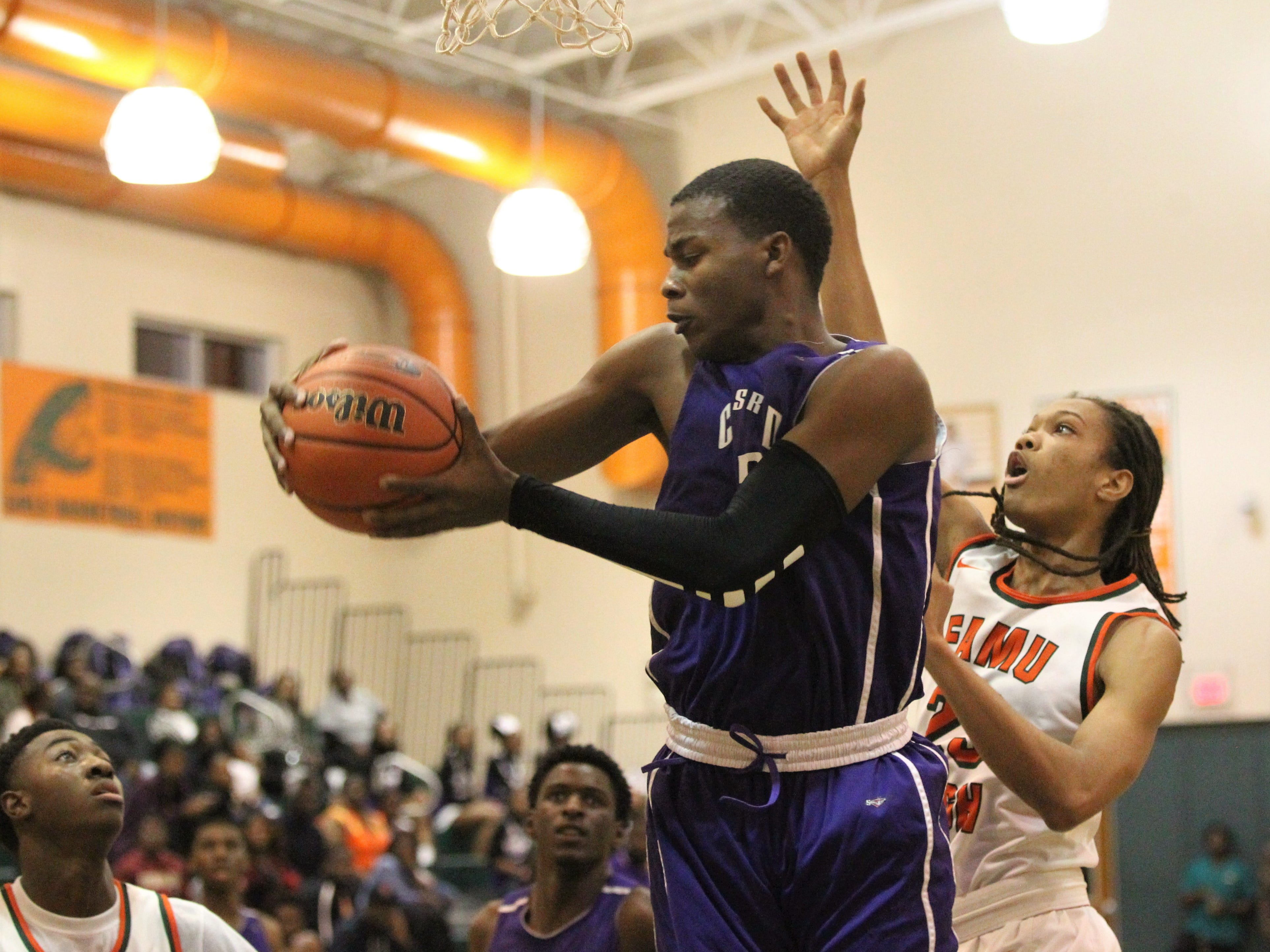 Dedric Streeter grabs a rebound as Crossroad Academy's boys basketball team plays at FAMU DRS on Jan. 7, 2019.