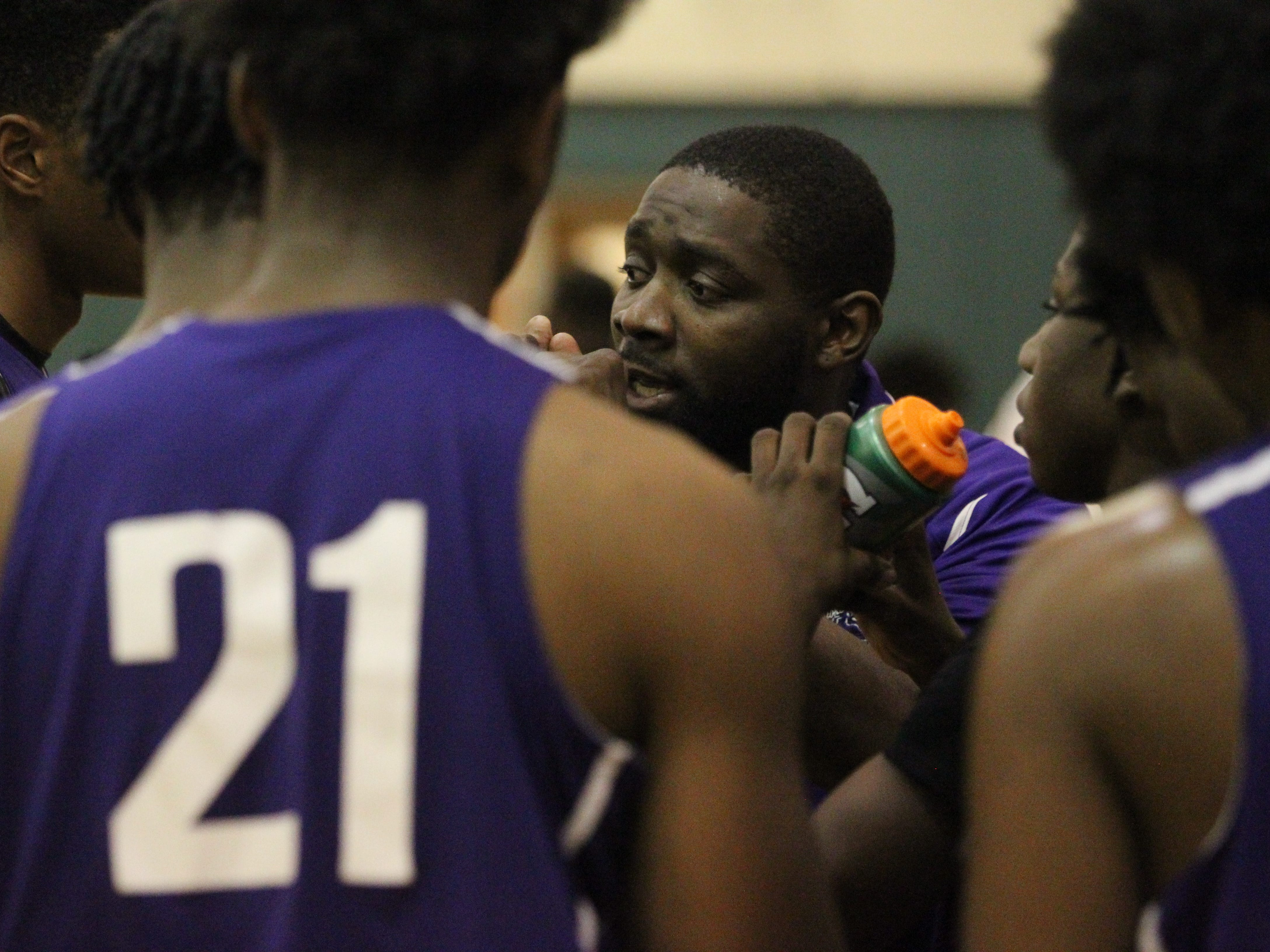 Crossroad Academy boys basketball coach AnDonte Gennie talks to his team as it plays at FAMU DRS on Jan. 7, 2019.