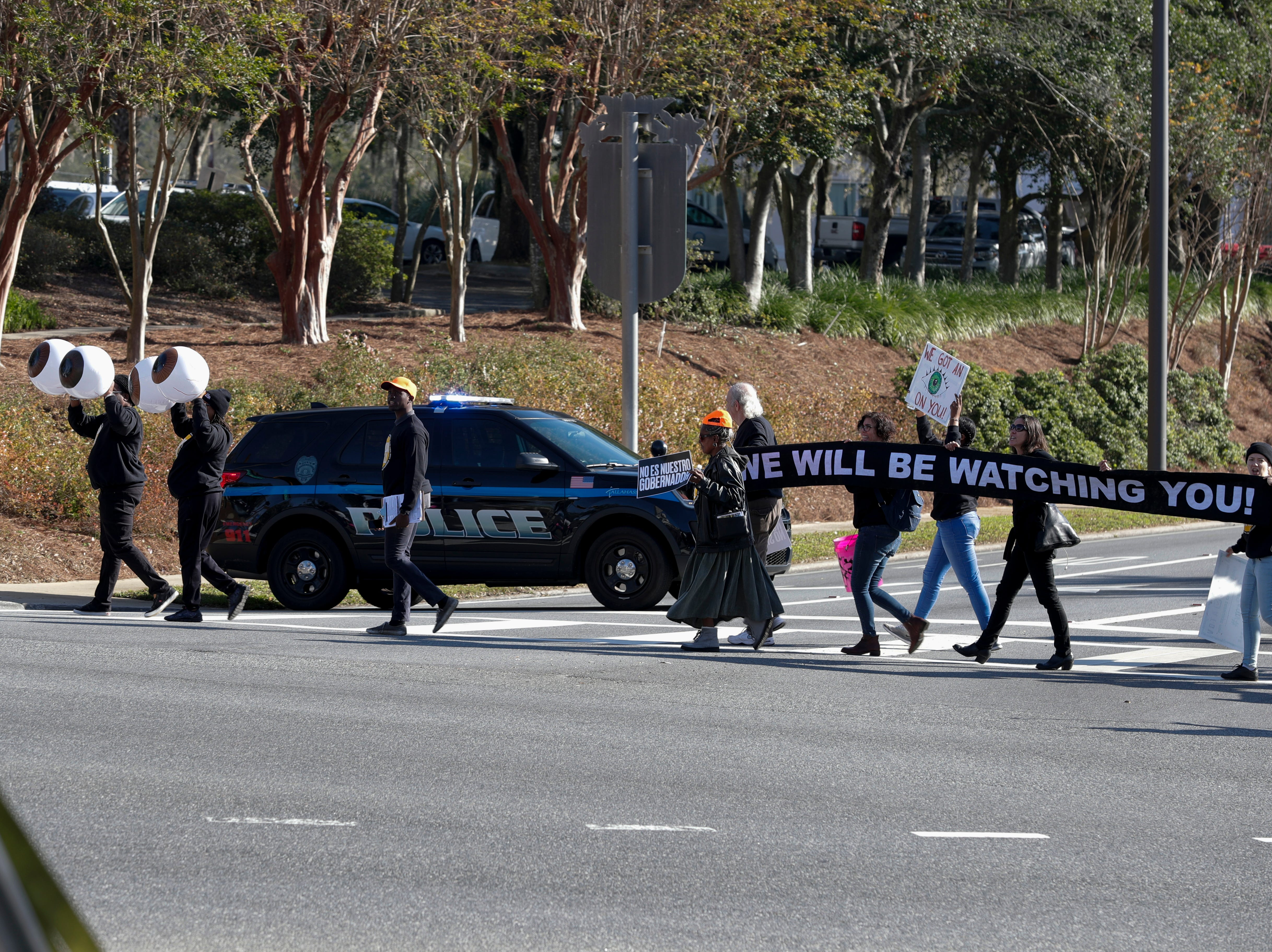 """""""Florida for All"""" protestors march along Monroe Street before the 2019 inauguration ceremony on the steps of the Historic Capitol Building in Tallahassee Tuesday, Jan. 8, 2019."""