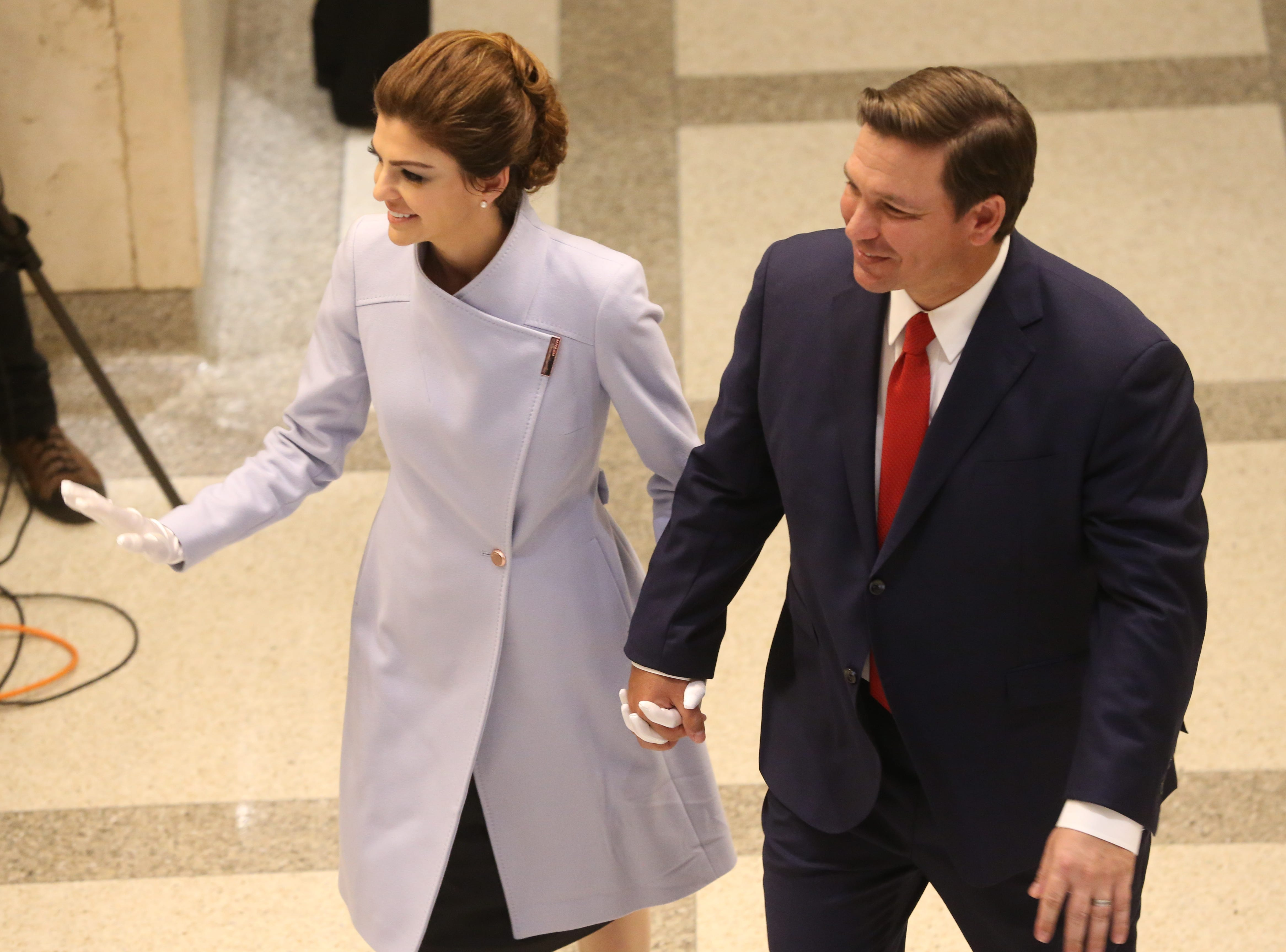 For the first time in Inaugural history, Gov. Ron DeSantis addresses FloridaÕs Legislative leaders and Cabinet officials. DeSantis discusses his plans to work with our stateÕs elected leaders to achieve a Bold Vision for a Brighter Future, Tuesday, Jan. 8, 2019. First lady Casey DeSantis waves to guests as she holds hands with her husband, Gov. Ron DeSantis.