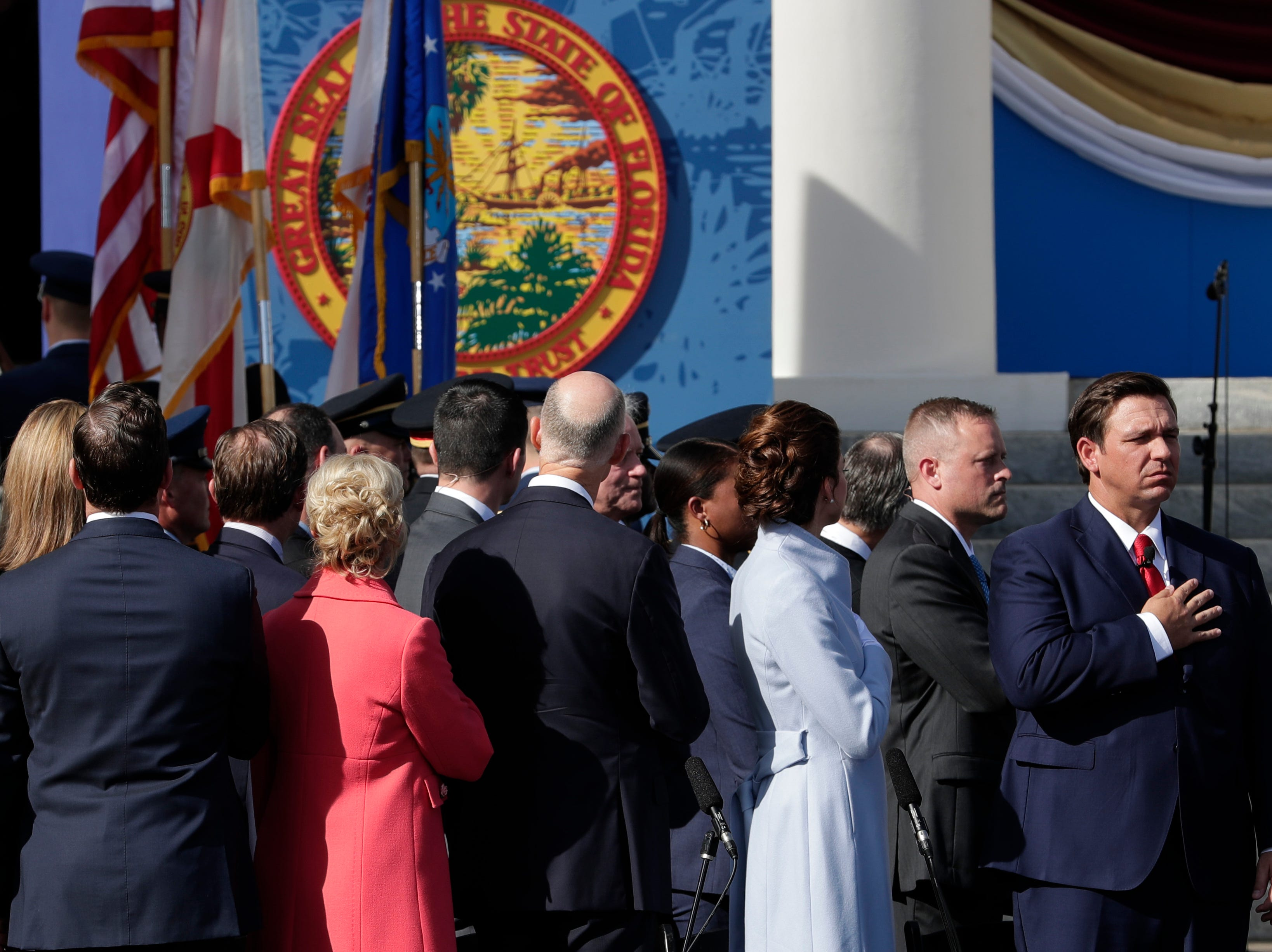 Gov. Ron DeSantis stands with his hand over his heart as the Florida National Guard performs the posting of the colors during the 2019 inauguration ceremony on the steps of the Historic Capitol Building in Tallahassee Tuesday, Jan. 8, 2019.