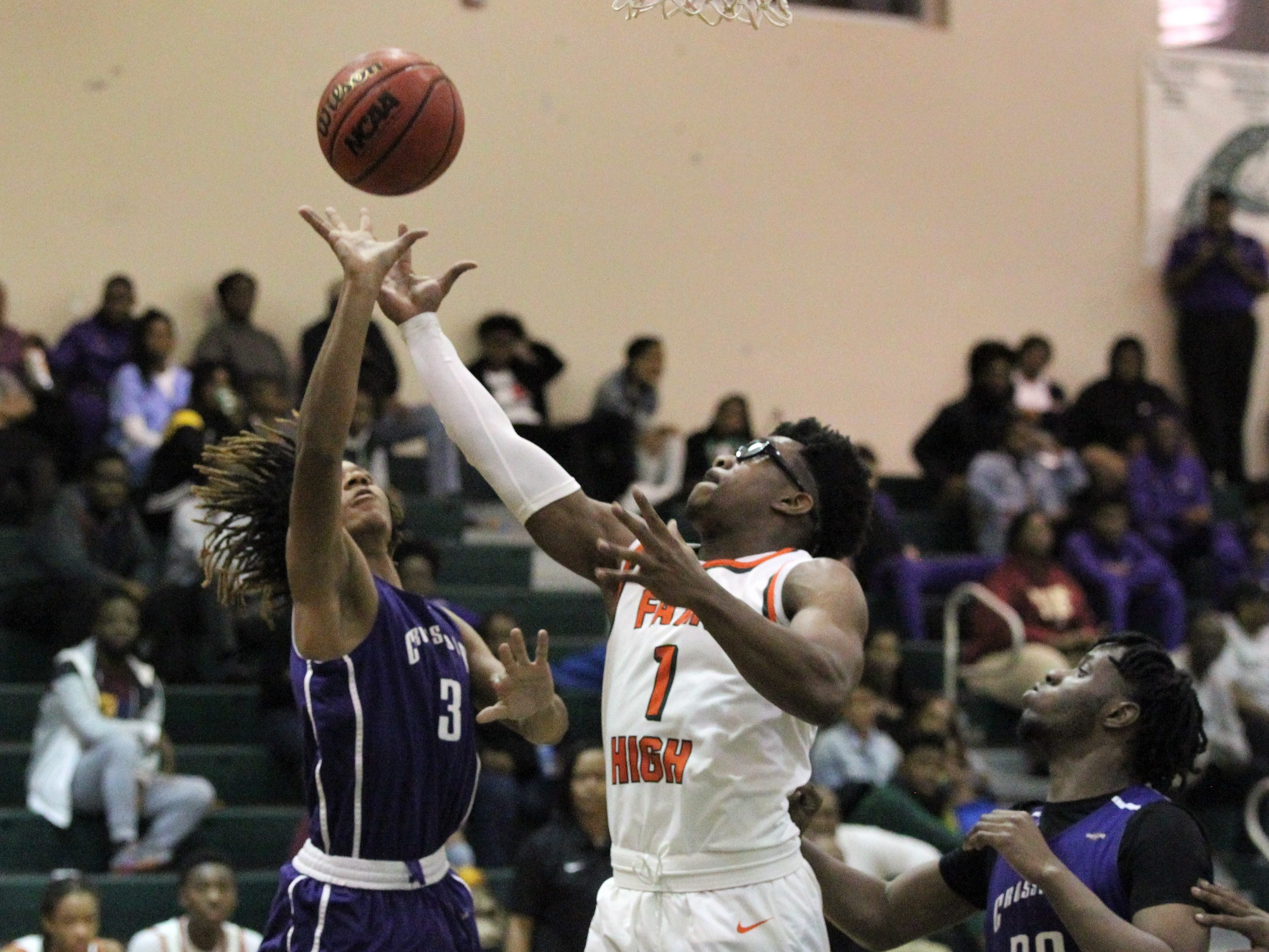 Daemari Wade (3) fights for a rebounds with FAMU DRS' Brian Green as Crossroad Academy's boys basketball team plays at FAMU DRS on Jan. 7, 2019.