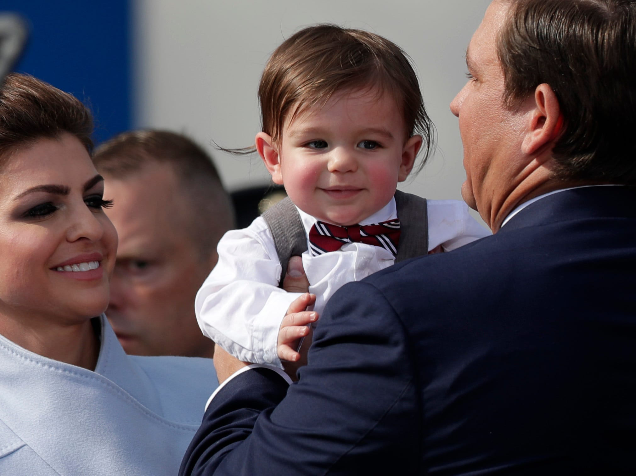 First lady Casey DeSantis passes her son Mason DeSantis to her husband Gov. Ron DeSantis during the 2019 inauguration ceremony on the steps of the Historic Capitol Building in Tallahassee Tuesday, Jan. 8, 2019.