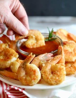 Pan-fried shrimp is cooked in a small amount of olive oil.