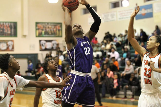 Dedric Streeter grabs a rebound and goes up for a putback as Crossroad Academy's boys basketball team plays at FAMU DRS on Jan. 7, 2019.