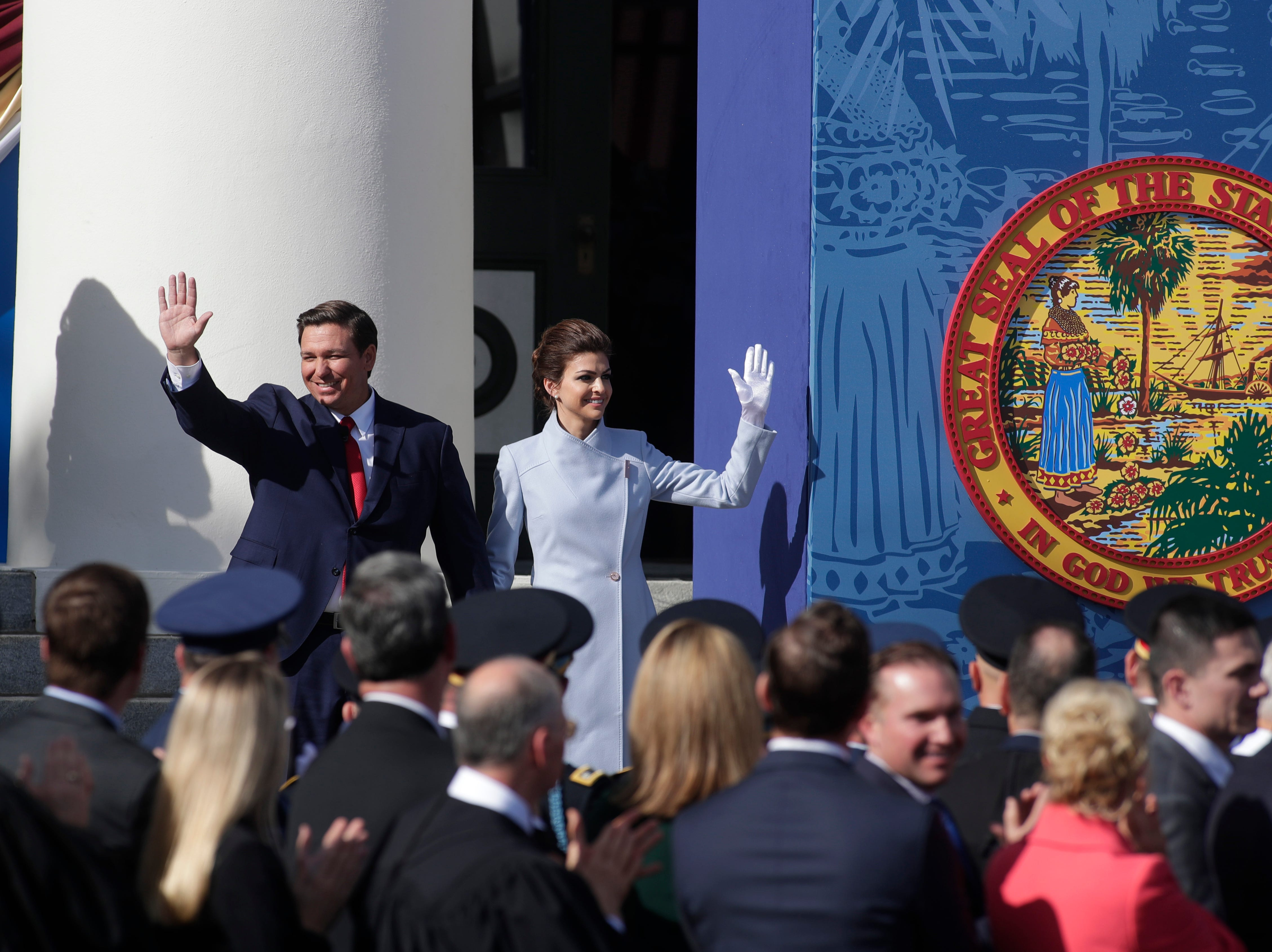 Gov. Ron DeSantis and his wife Casey DeSantis wave to the crowd during the 2019 inauguration ceremony on the steps of the Historic Capitol Building in Tallahassee Tuesday, Jan. 8, 2019.