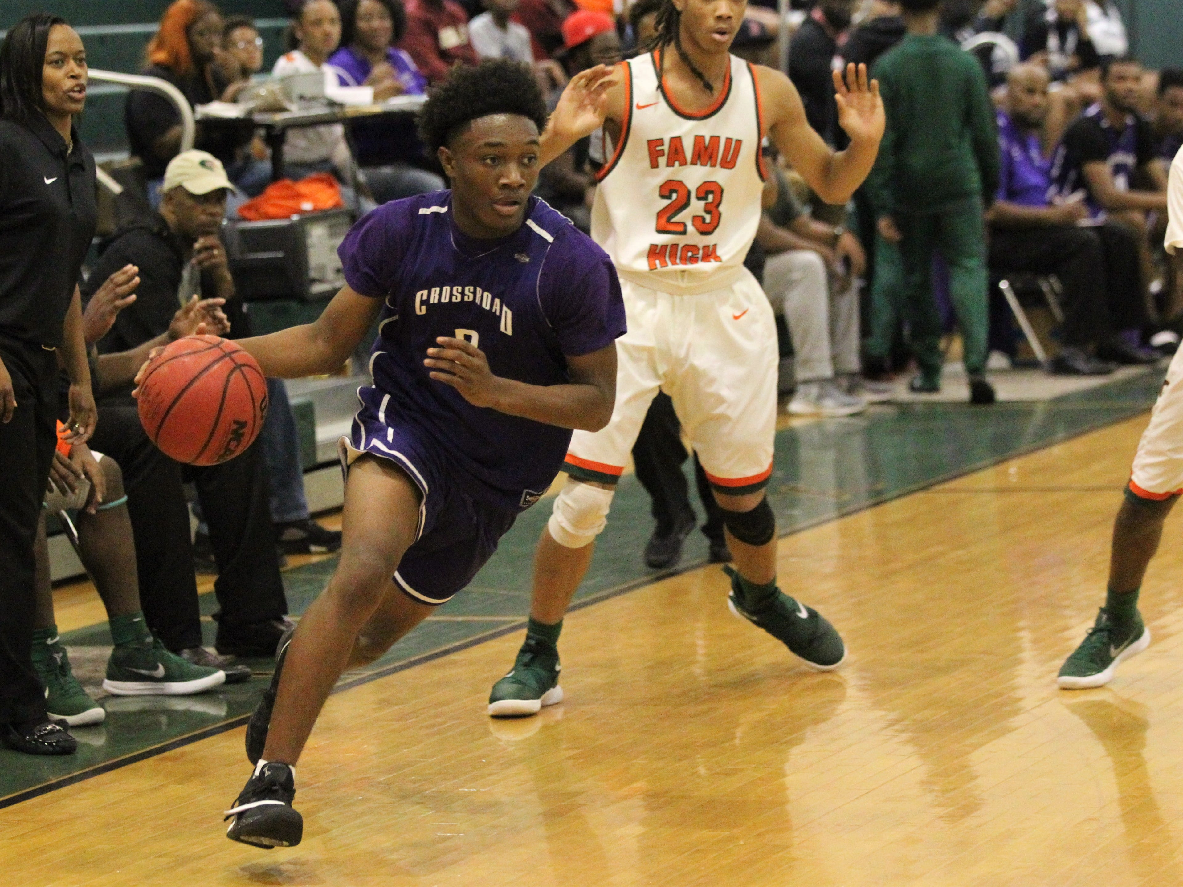 Jeremiah Outley drives as Crossroad Academy's boys basketball team plays at FAMU DRS on Jan. 7, 2019.