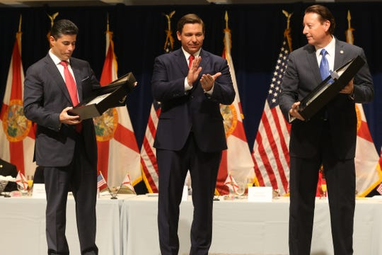 For the first time in Inaugural history, Gov. Ron DeSantis addresses FloridaÕs Legislative leaders and Cabinet officials. DeSantis discusses his plans to work with our stateÕs elected leaders to achieve a Bold Vision for a Brighter Future, Tuesday, Jan. 8, 2019.  Gov. Ron DeSantis, center, gives a flag that was flown during the inauguration earlier in the morning to House Speaker Jose Oliva, left, and Senate President Bill Galvano, right.