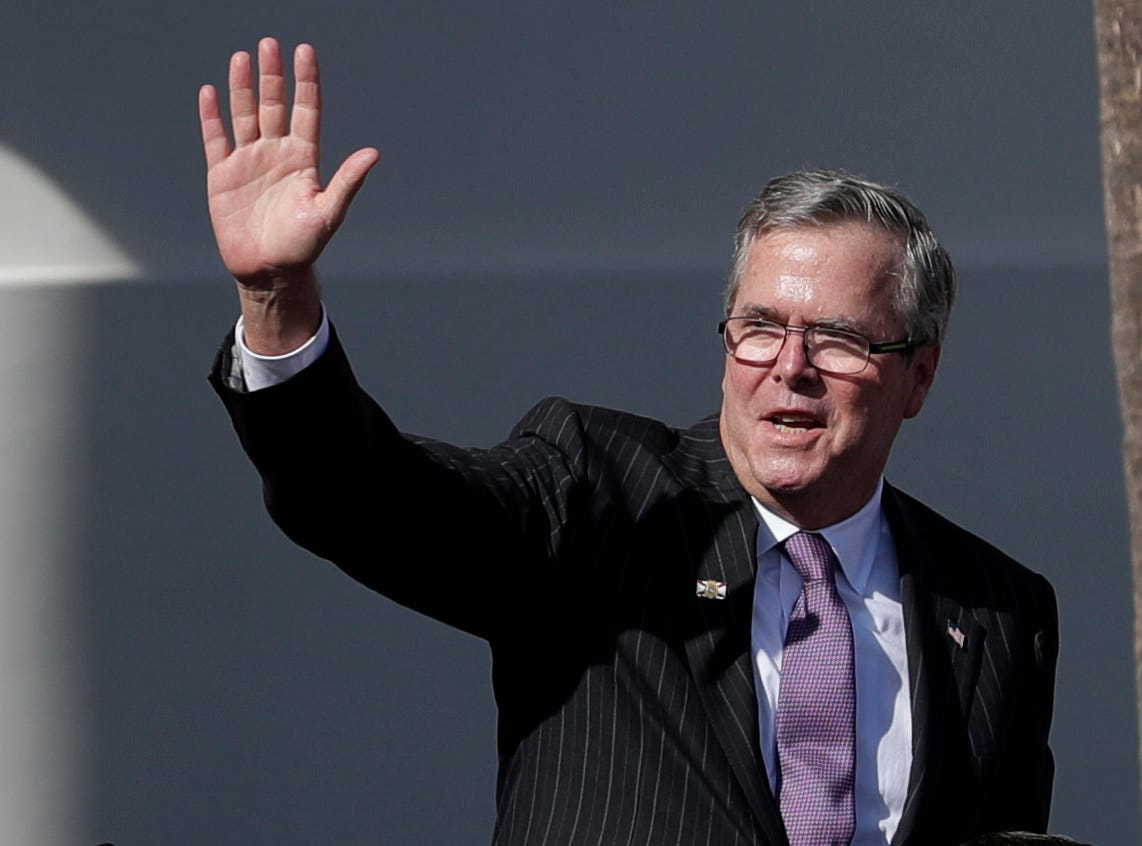 Former Governor Jeb Bush waves to the crowd during the 2019 inauguration ceremony on the steps of the Historic Capitol Building in Tallahassee Tuesday, Jan. 8, 2019.