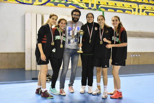 TCC center Nesma Khalifa (center) celebrates with her teammates and coach Ahmed Gomaa. She now competes with the Eagles as the first Egyptian-born player.