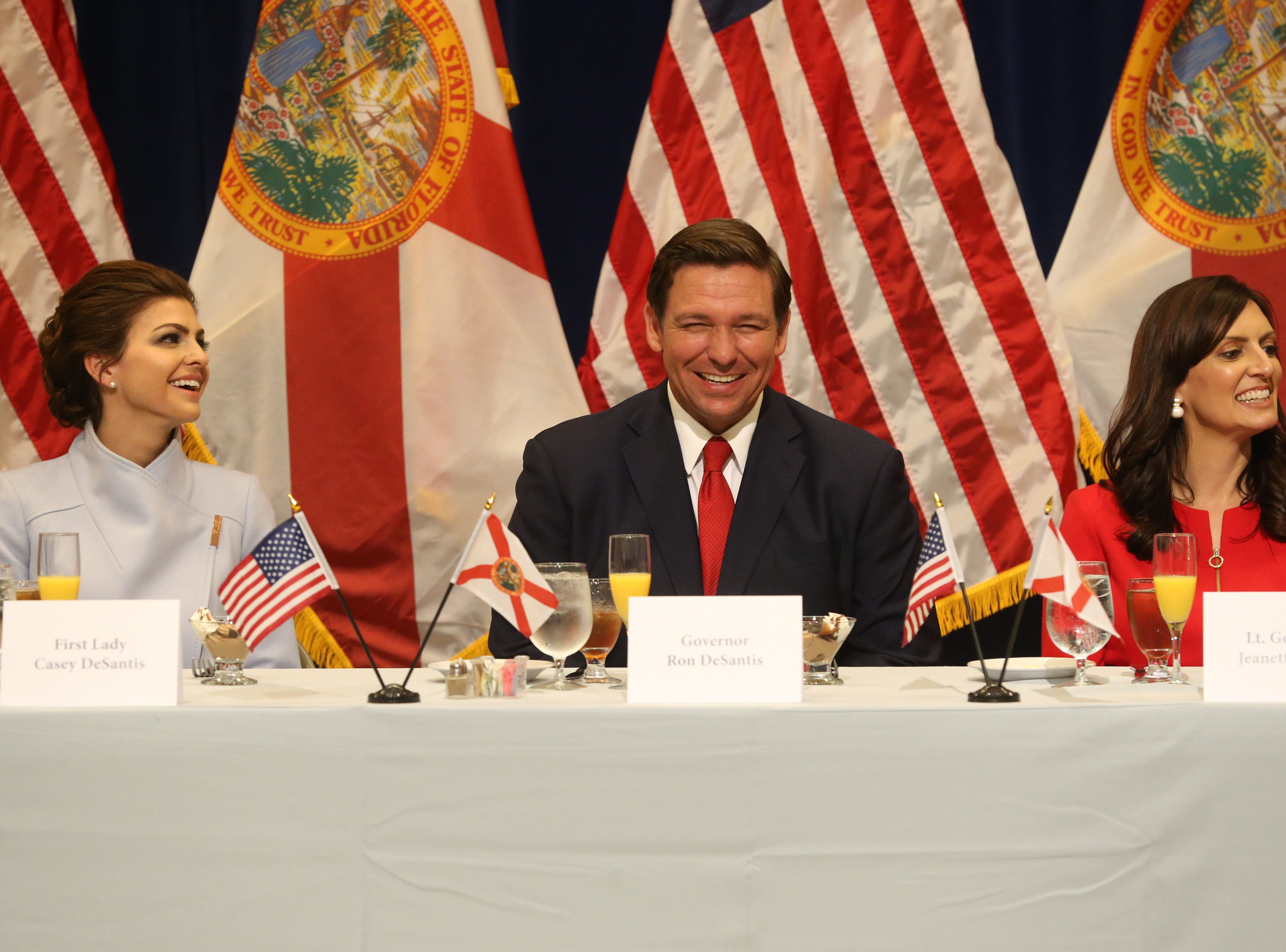 For the first time in Inaugural history, Gov. Ron DeSantis addresses FloridaÕs Legislative leaders and Cabinet officials. DeSantis discusses his plans to work with our stateÕs elected leaders to achieve a Bold Vision for a Brighter Future, Tuesday, Jan. 8, 2019. First lady Casey DeSantis, left, Gov. Ron DeSantis, and Lt. Gov. Jeanette Nunez laugh during a toast given by Senate President Bill Galvano.