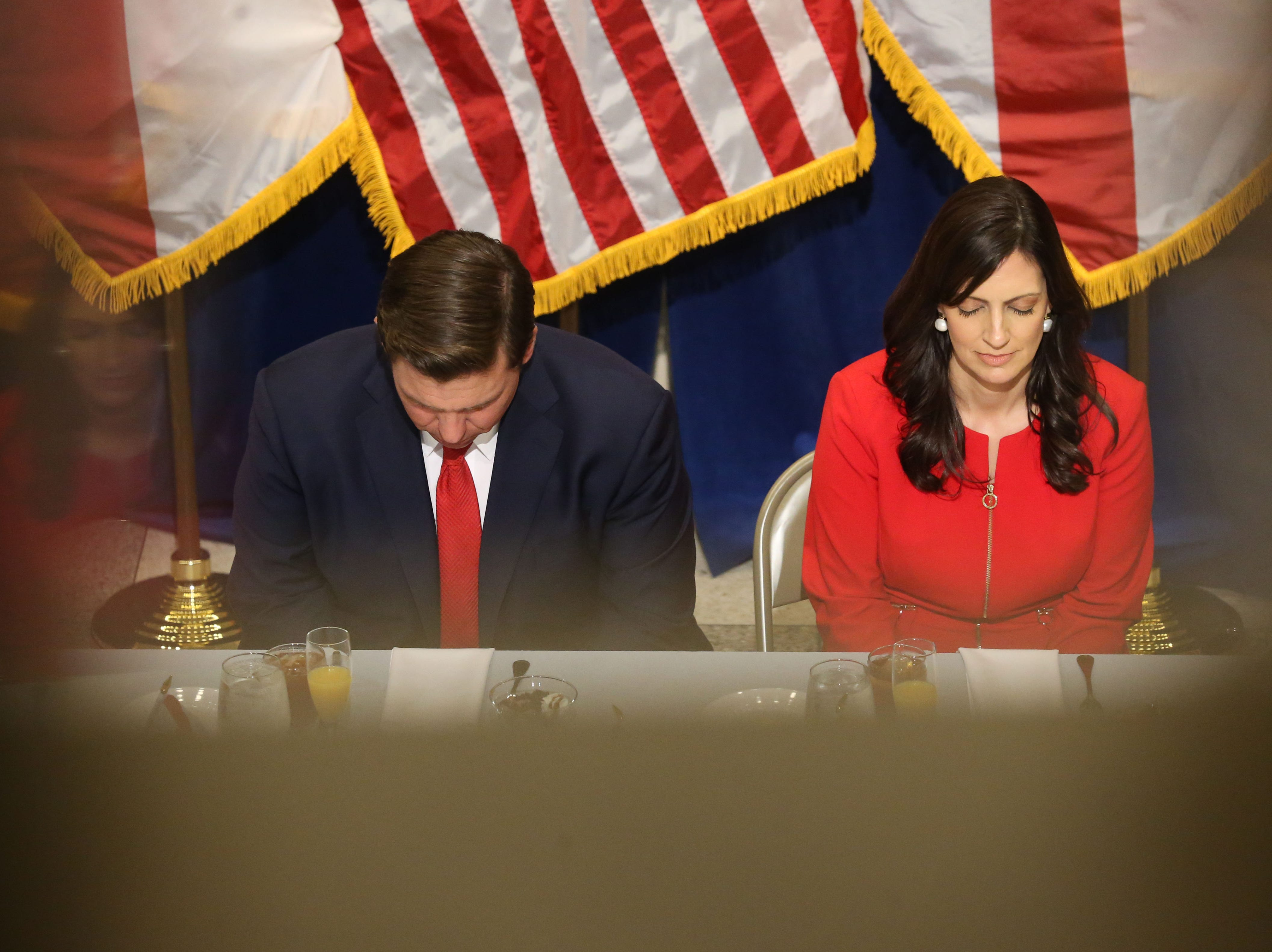 For the first time in Inaugural history, Gov. Ron DeSantis addresses FloridaÕs Legislative leaders and Cabinet officials. DeSantis discusses his plans to work with our stateÕs elected leaders to achieve a Bold Vision for a Brighter Future, Tuesday, Jan. 8, 2019. Gov. Ron DeSantis, left, and Lt. Gov. Jeanette Nunez, bow their head in prayer before the start of the luncheon.
