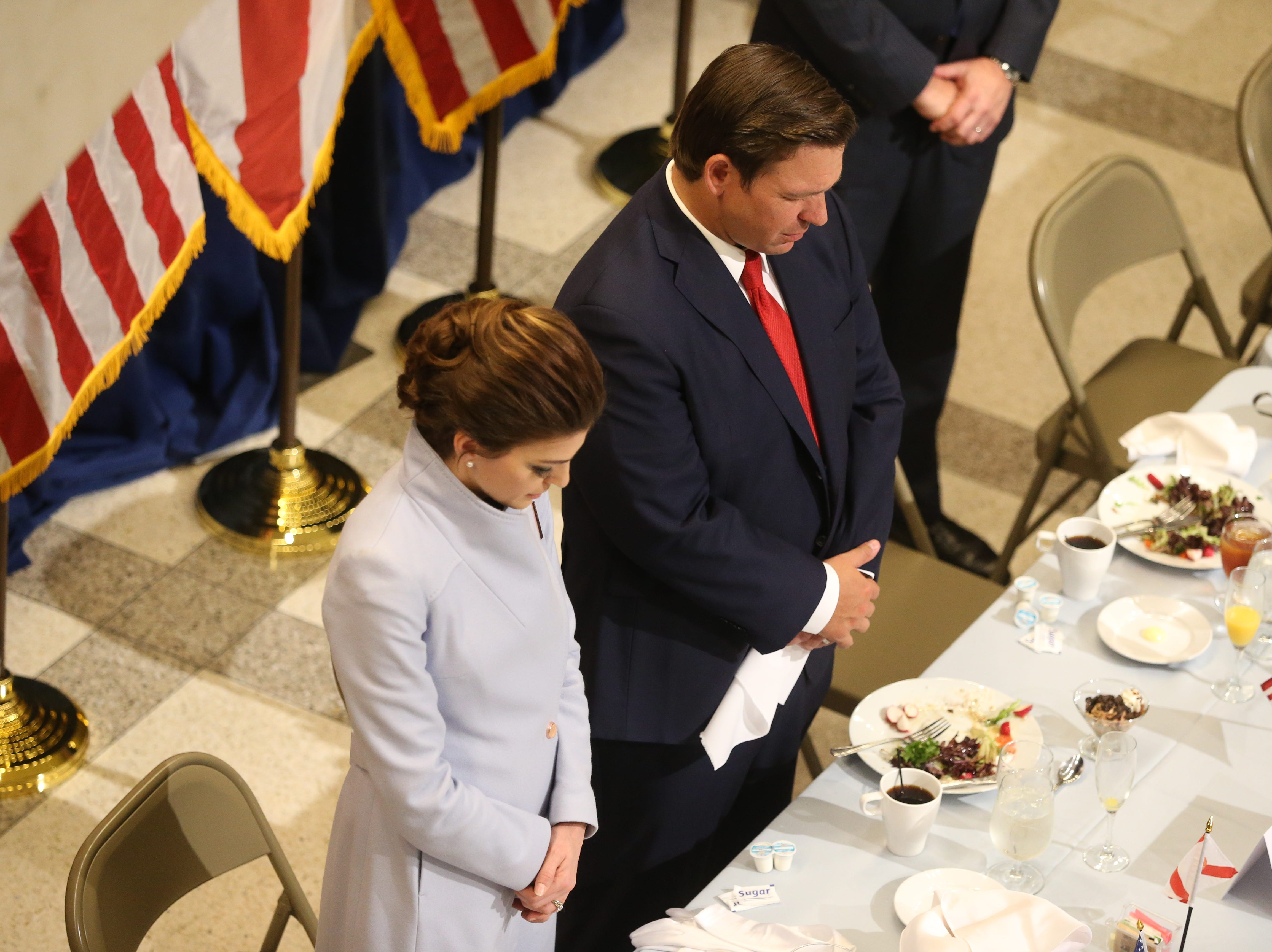 For the first time in Inaugural history, Gov. Ron DeSantis addresses FloridaÕs Legislative leaders and Cabinet officials. DeSantis discusses his plans to work with our stateÕs elected leaders to achieve a Bold Vision for a Brighter Future, Tuesday, Jan. 8, 2019. First lady Casey DeSantis, left, and her husband, Gov. Ron DeSantis bow their head in prayer at the closing of the luncheon.