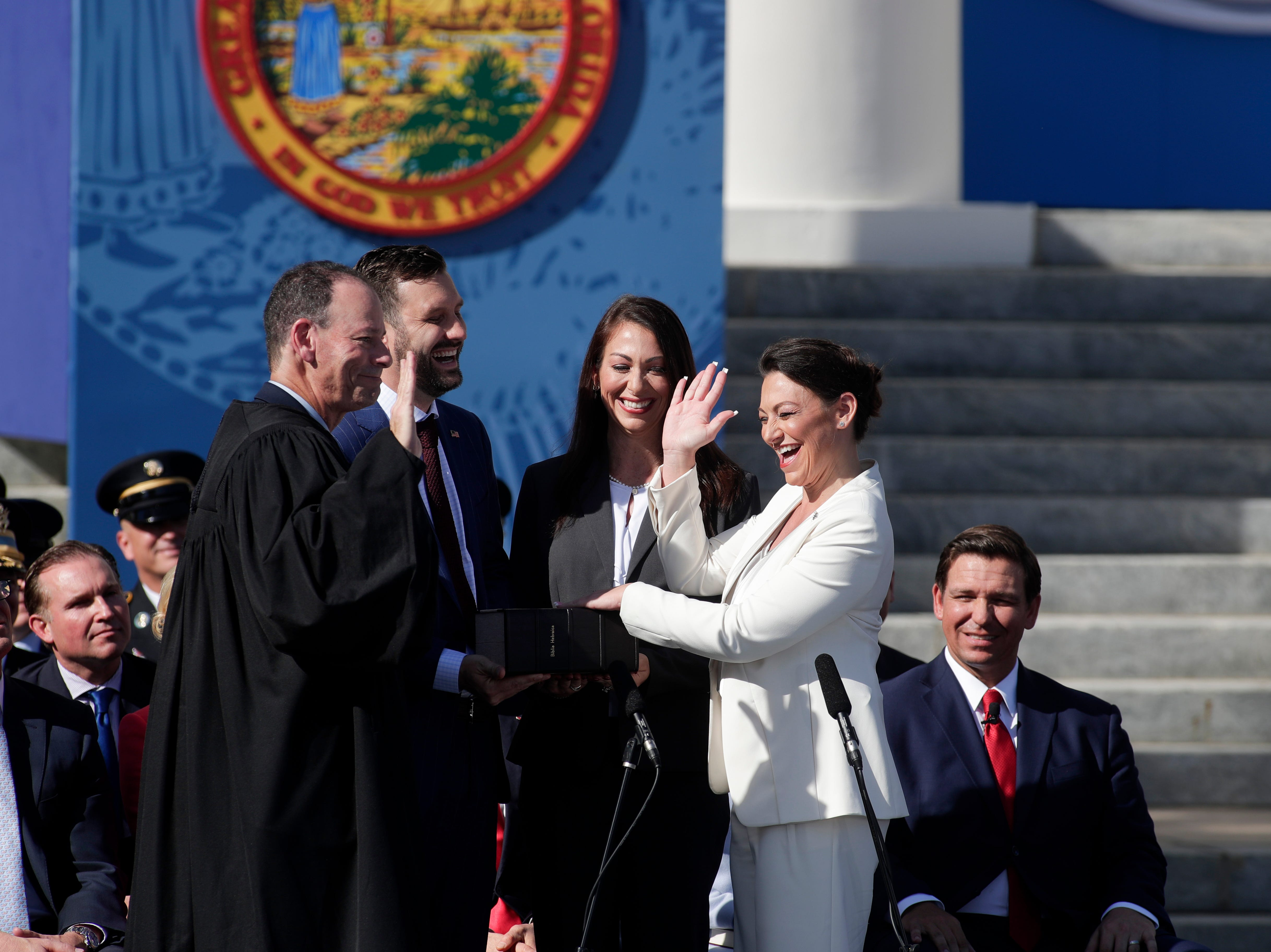 Commissioner of Agriculture and Consumer Services Nikki Fried laughs as she slips up reciting the words of her Oath of Office during the 2019 inauguration ceremony on the steps of the Historic Capitol Building in Tallahassee Tuesday, Jan. 8, 2019.