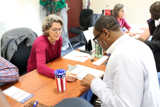 The Supervisor of Elections office has constant foot-traffic on Tuesday, Jan. 8, 2019, as Amendment 4 is now in effect. The Amendment restored the right to vote for felons not convicted on sex offenses or murder. Genny Rosenberg, left, a volunteer for the Supervisor of Elections Office walks Gregory James through the process of registering to vote.