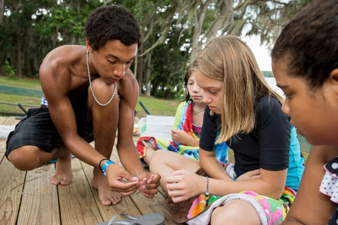 4H youth enjoying summer camp activities at Camp Cherry Lake near Madison.