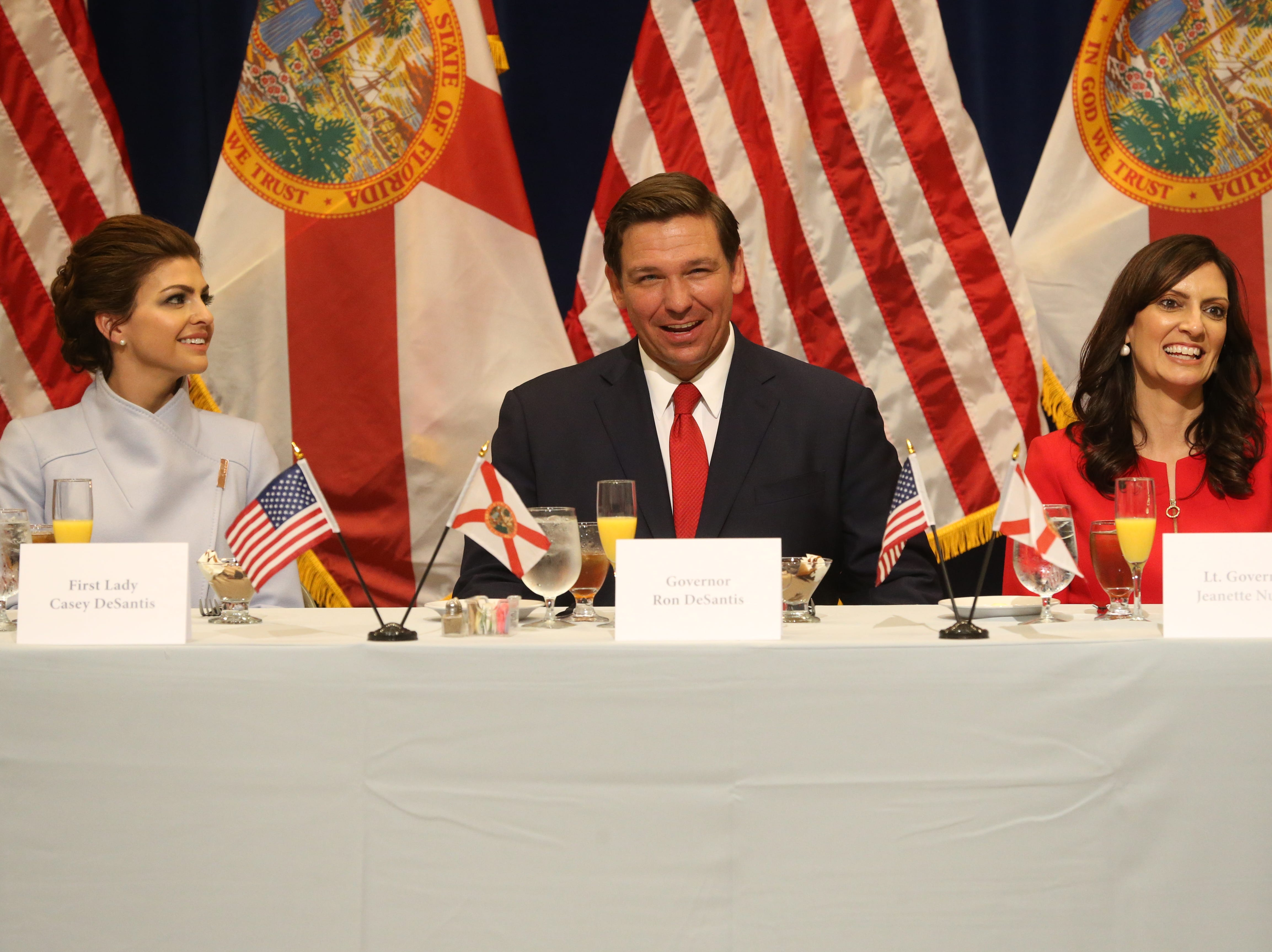 For the first time in Inaugural history, Gov. Ron DeSantis addresses FloridaÕs Legislative leaders and Cabinet officials. DeSantis discusses his plans to work with our stateÕs elected leaders to achieve a Bold Vision for a Brighter Future, Tuesday, Jan. 8, 2019. First lady Casey DeSantis, left, Gov. Ron DeSantis, and Lt. Gov. Jeanette Nunez chuckle during a toast.