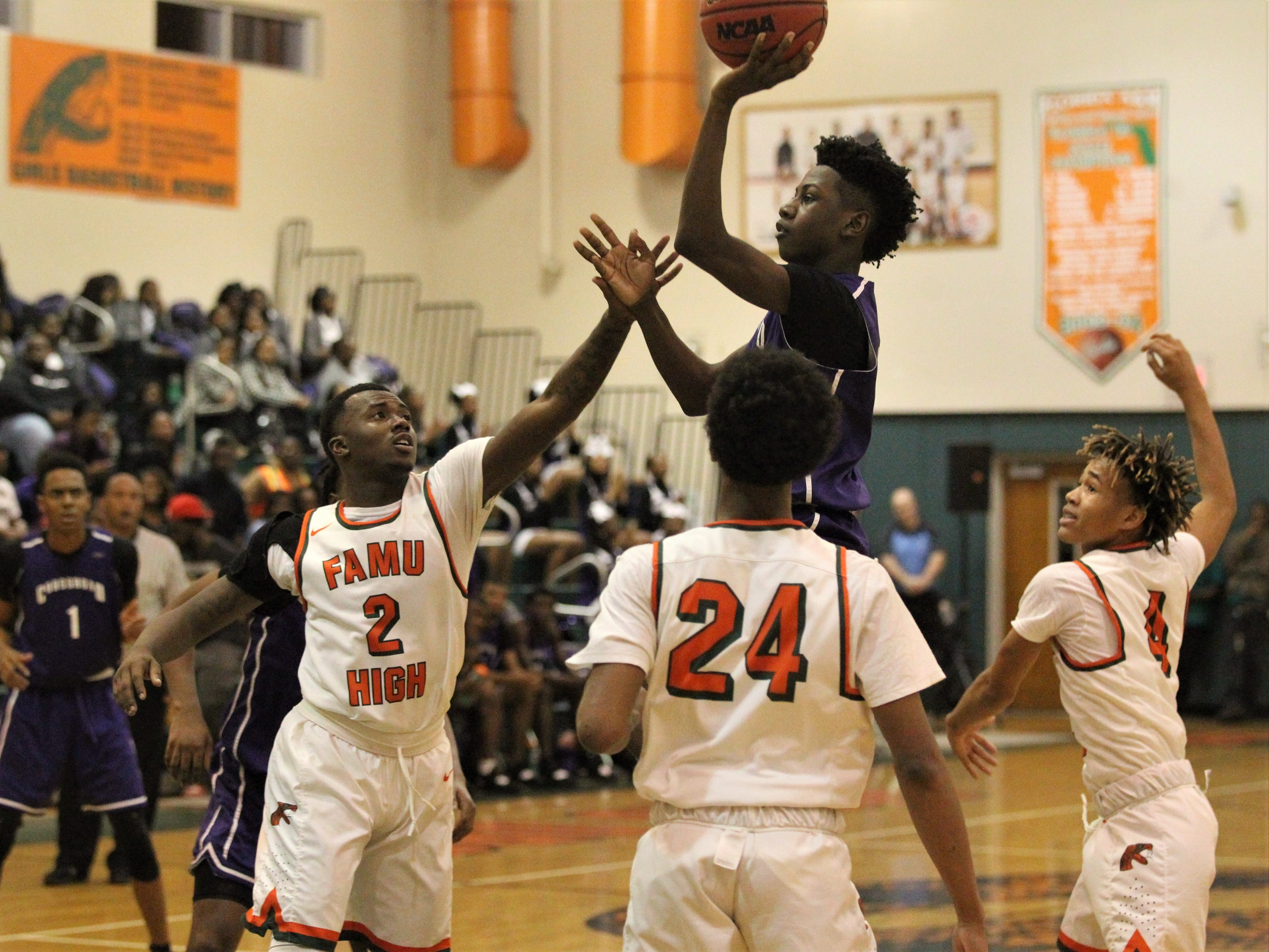 Deonta Jones goes for a floater in traffic as Crossroad Academy's boys basketball team plays at FAMU DRS on Jan. 7, 2019.