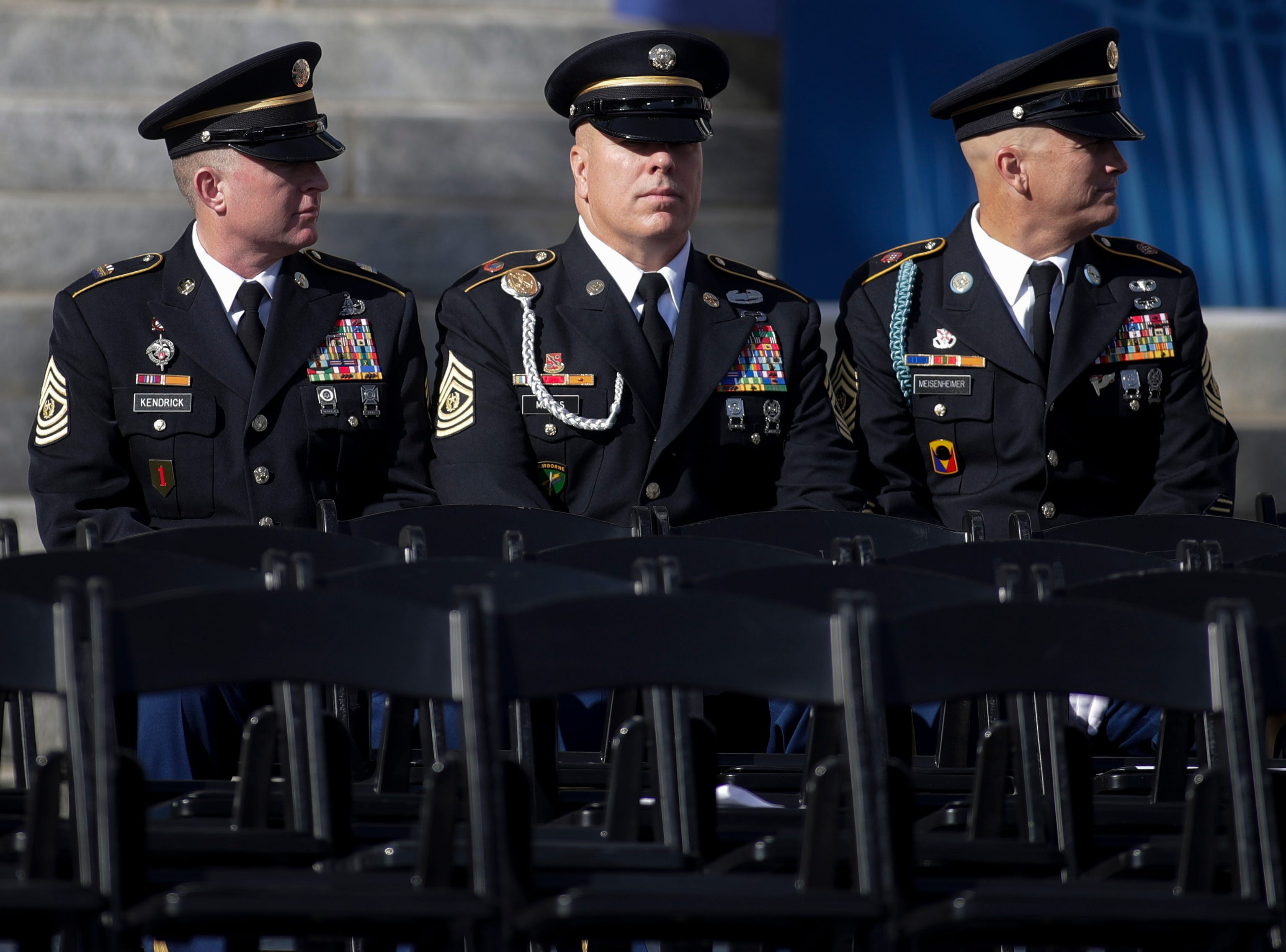 Members of the military take their seats on stage before the 2019 inauguration ceremony on the steps of the Historic Capitol Building in Tallahassee Tuesday, Jan. 8, 2019.