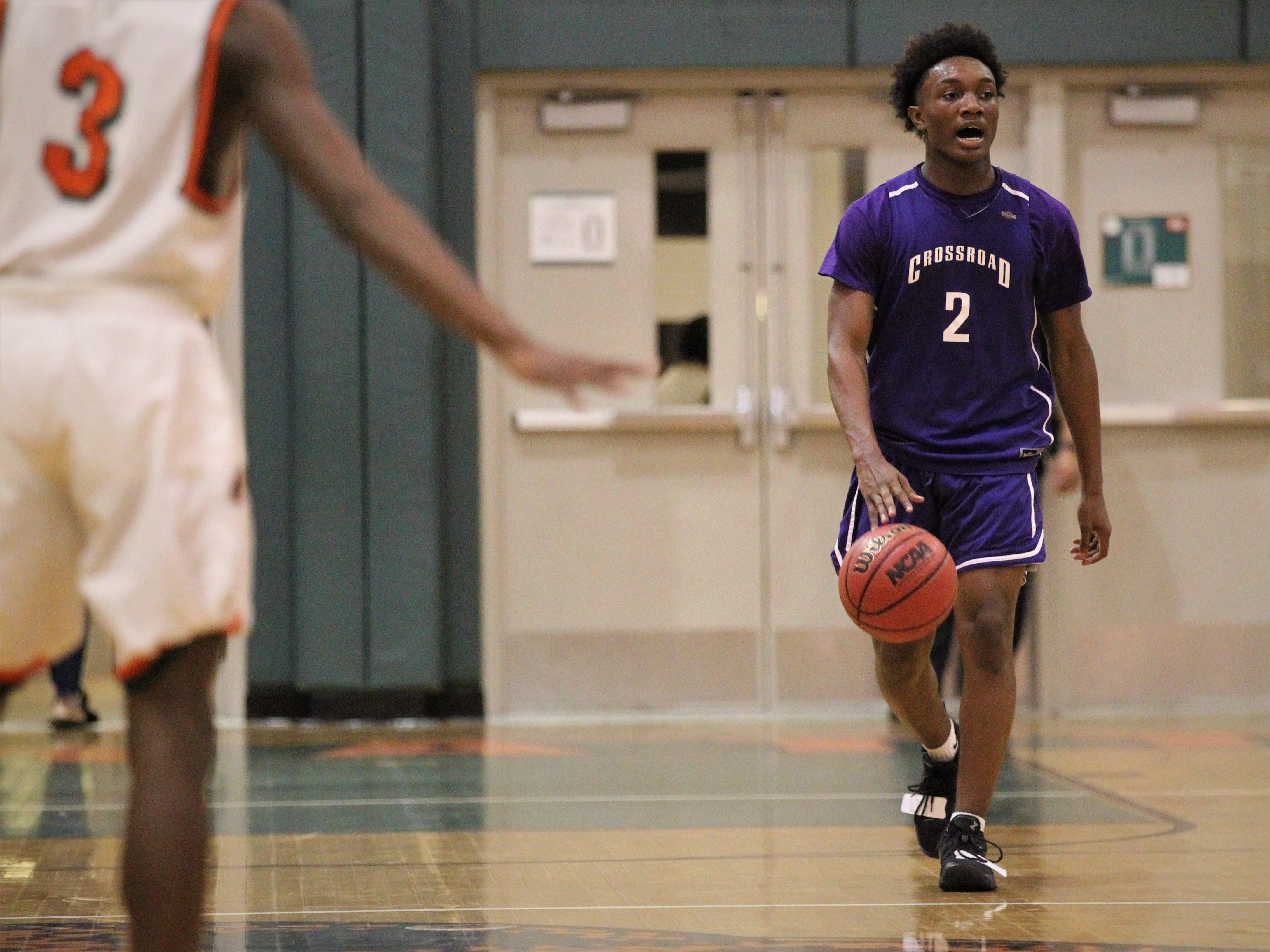 Jeremiah Outley brings the ball up the court as Crossroad Academy's boys basketball team plays at FAMU DRS on Jan. 7, 2019.