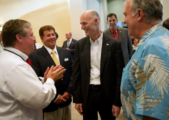 Florida Gov. Rick Scott (second from right) laughs with County Commissioner Wesley Davis (left), Tom Lockwood, chairman of the Indian River County Republican Executive Committee, and Gene Waddell, while visiting The Club at Pointe West for a meet and greet May 1, 2012. In one of Scott's last acts as governor Jan. 7, 2019, he appointed Davis as Indian River County's property appraiser.
