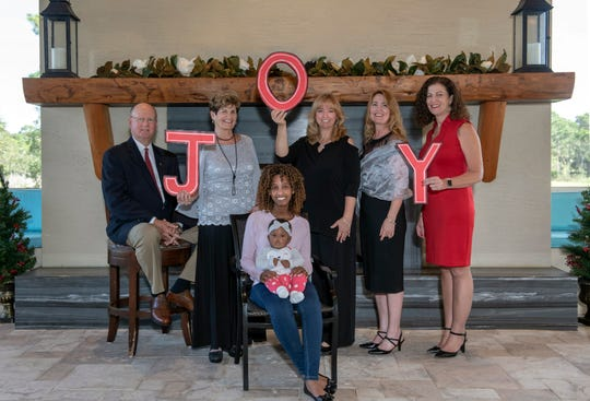 """Joy"" is the theme of the 2019 Mary's Shelter gala. Pictured are, from left, standing, John Glynn Jr., Florence Oreiro, Angie Leggio, Madeleine Greenwood and Gina Thompson. Seated is Mary's Shelter resident Wilmene with her daughter, Khalani."
