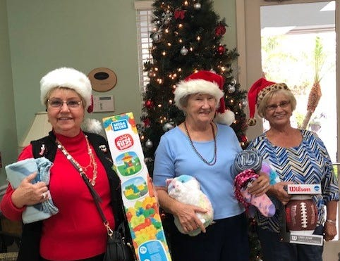 Hammock Lakes Housing Development donated gifts and gift cards. Pictured are Linda Gartland, left, Carol Ziarnowski and Paulette Martin. This is the 12th year they have supported the teens living at the Hibiscus Village in Vero Beach.